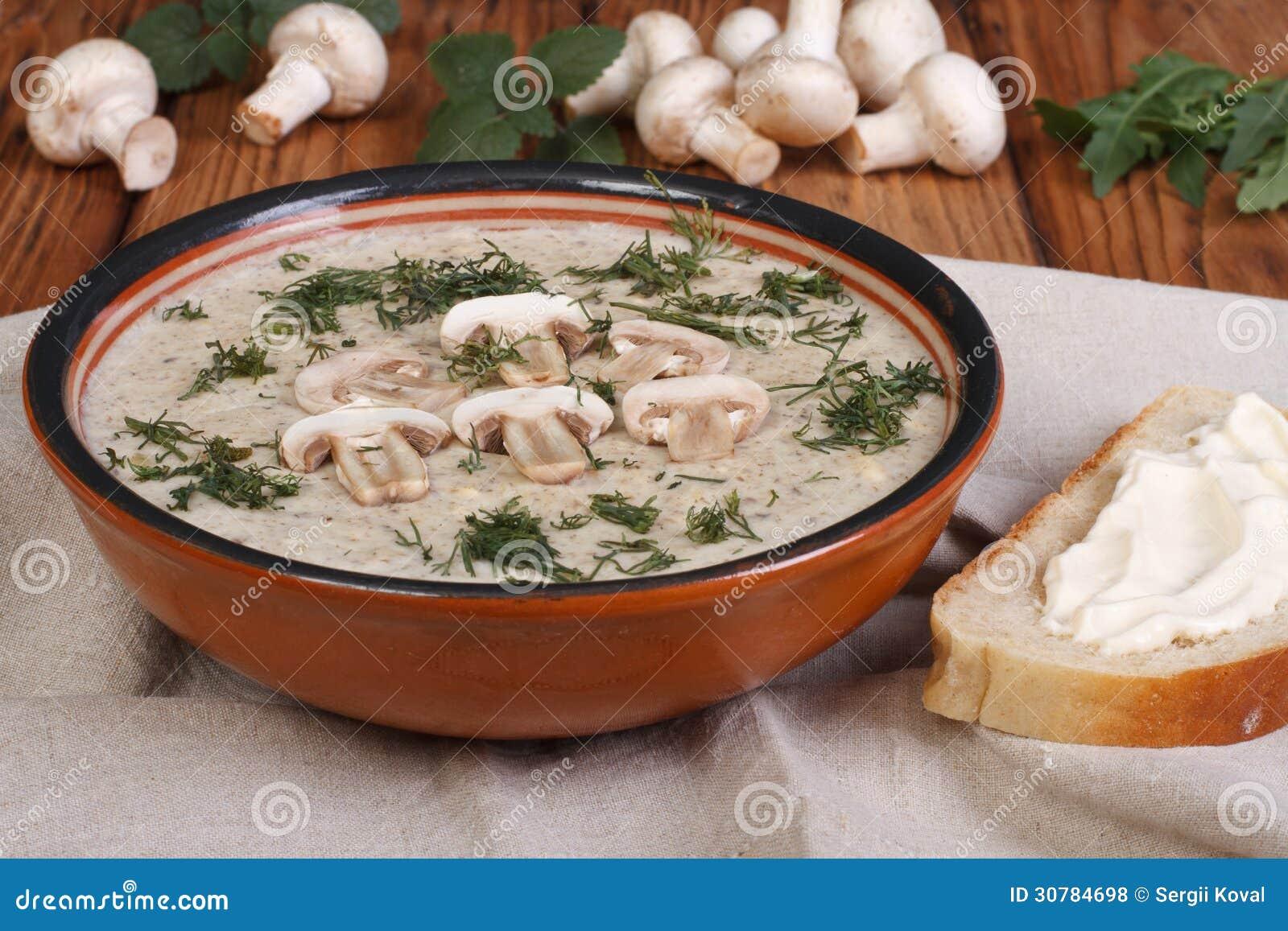 Mushroom cream soup with mushrooms and milk cream with herbs.