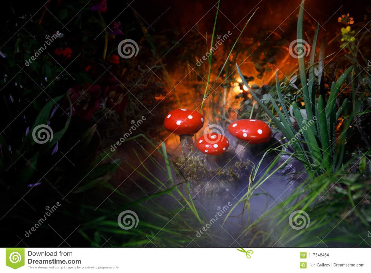 Mushroom. Fantasy Glowing Mushrooms in mystery dark forest close-up. Amanita muscaria, Fly Agaric in moss in forest. Magic mushroo