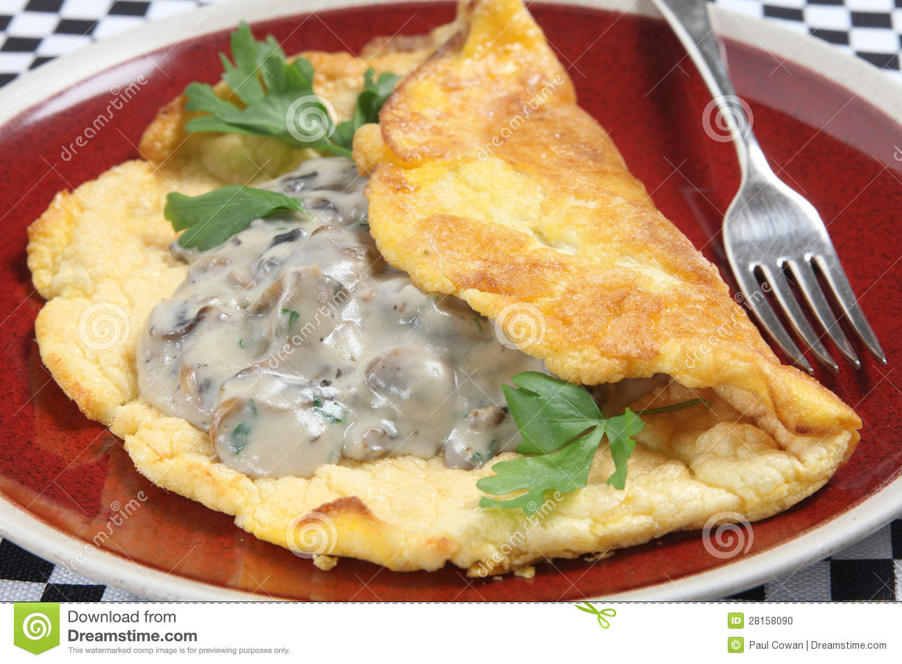 homemade souffle omelet served with mushrooms in a creamy sauce ...