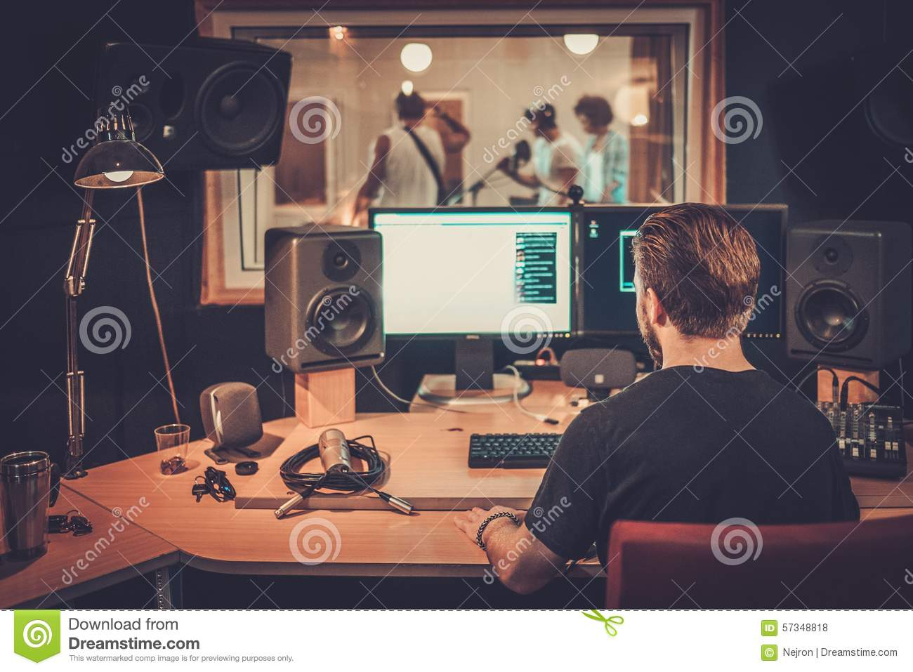 Music band in a cd recording studio