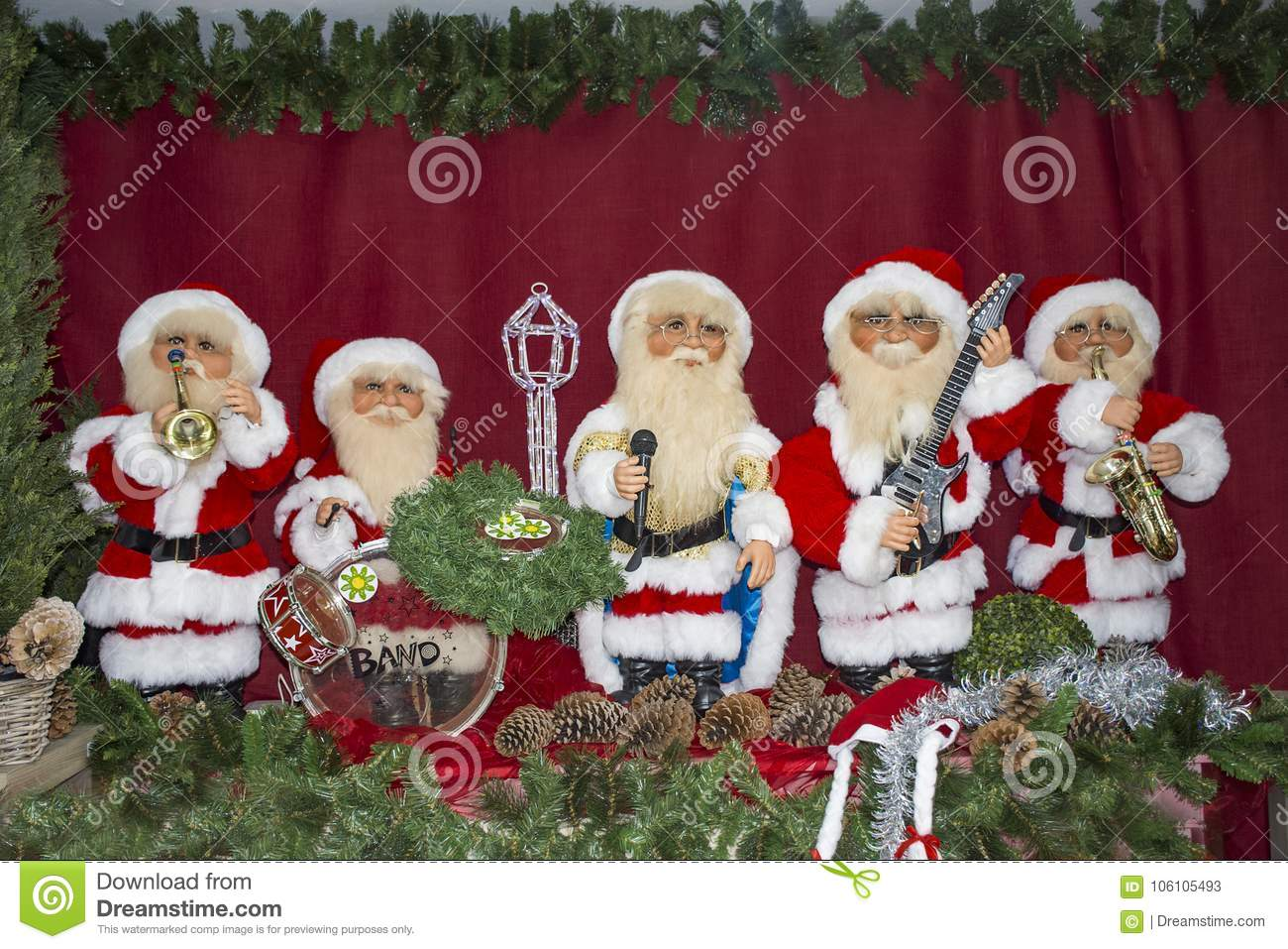 santa claus toys celebrate christmas playing various music instruments and singing - Singing Christmas Toys
