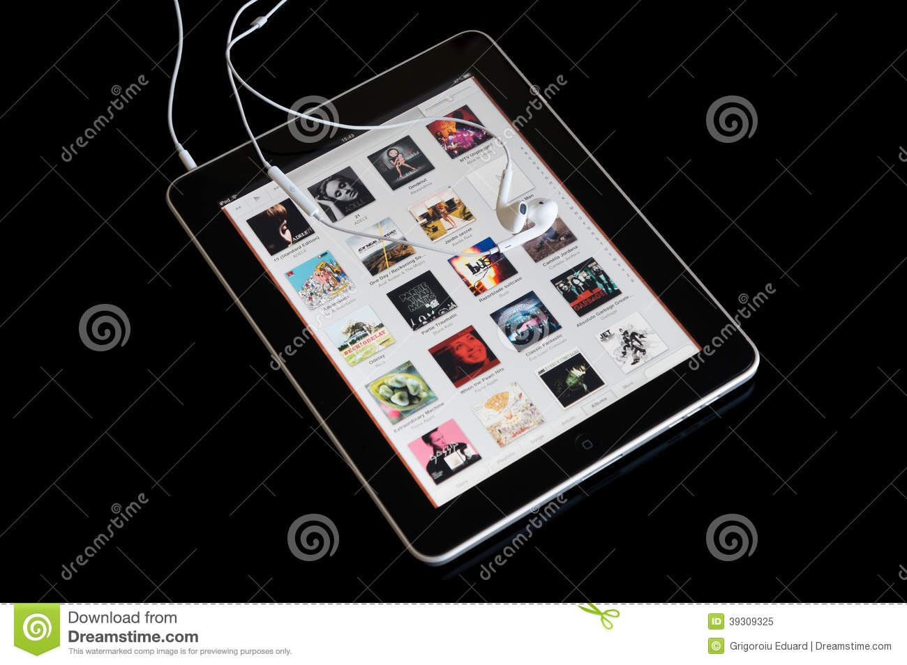 Music Player On Ipad With Earphones Editorial Image - Image