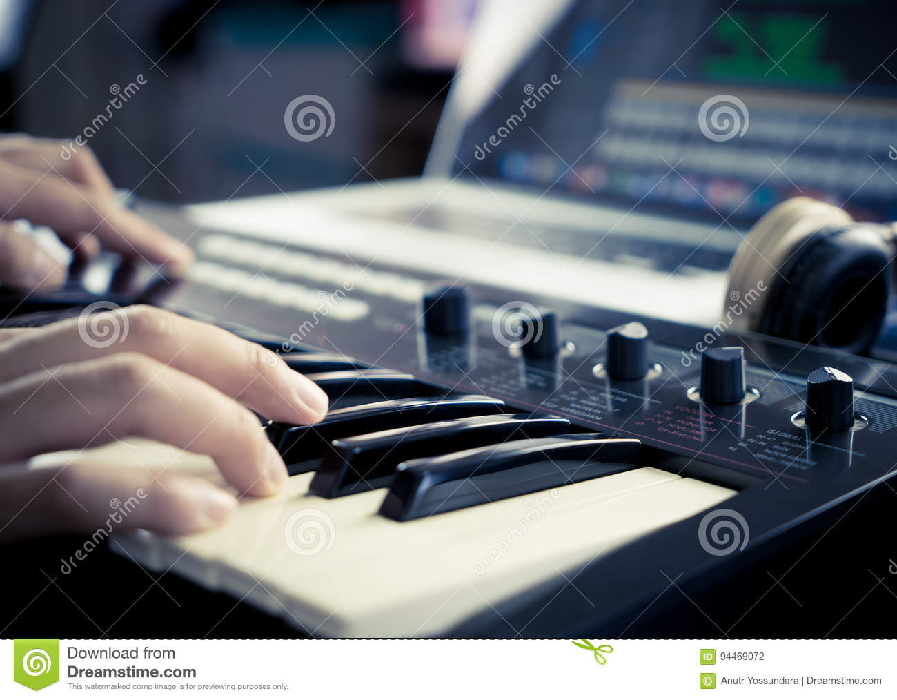 Music producer is working with Synthesizer
