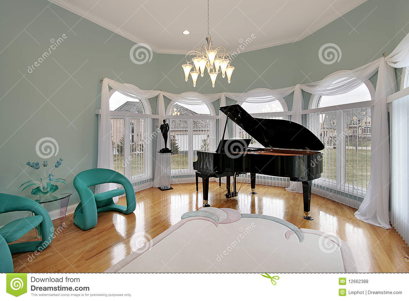 Empty room with chair violin and sheet music on floor photograph - Music Room With Green Chairs Royalty Free Stock Photos