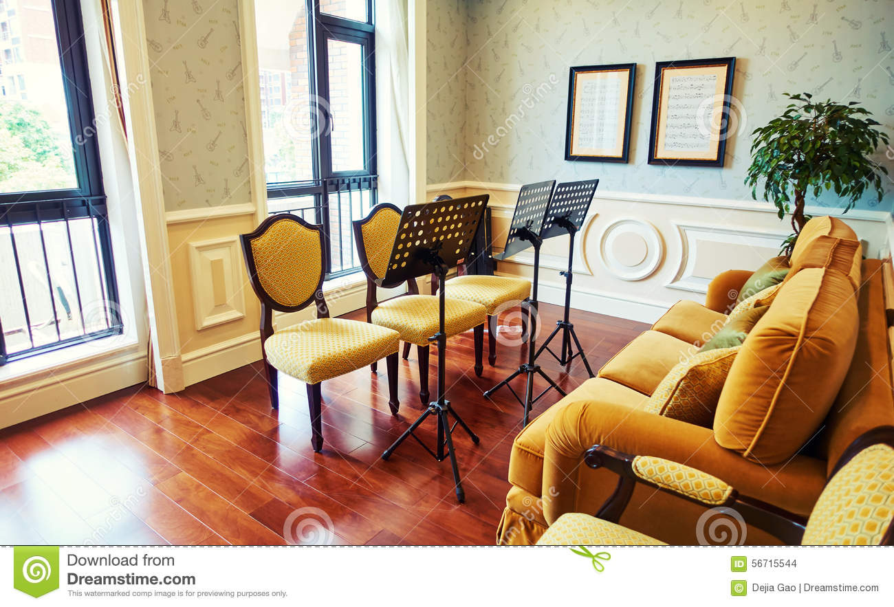 sitting room with furniture music stand stock photo