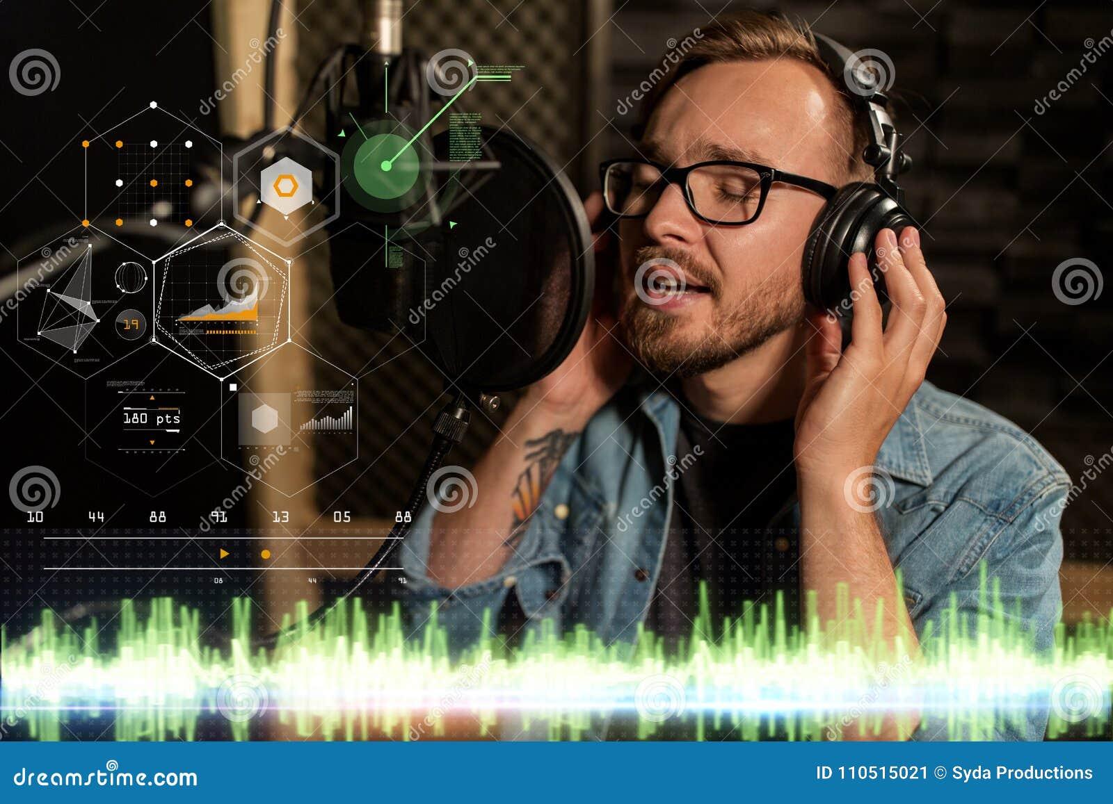 Man With Headphones Singing At Recording Studio Stock Image