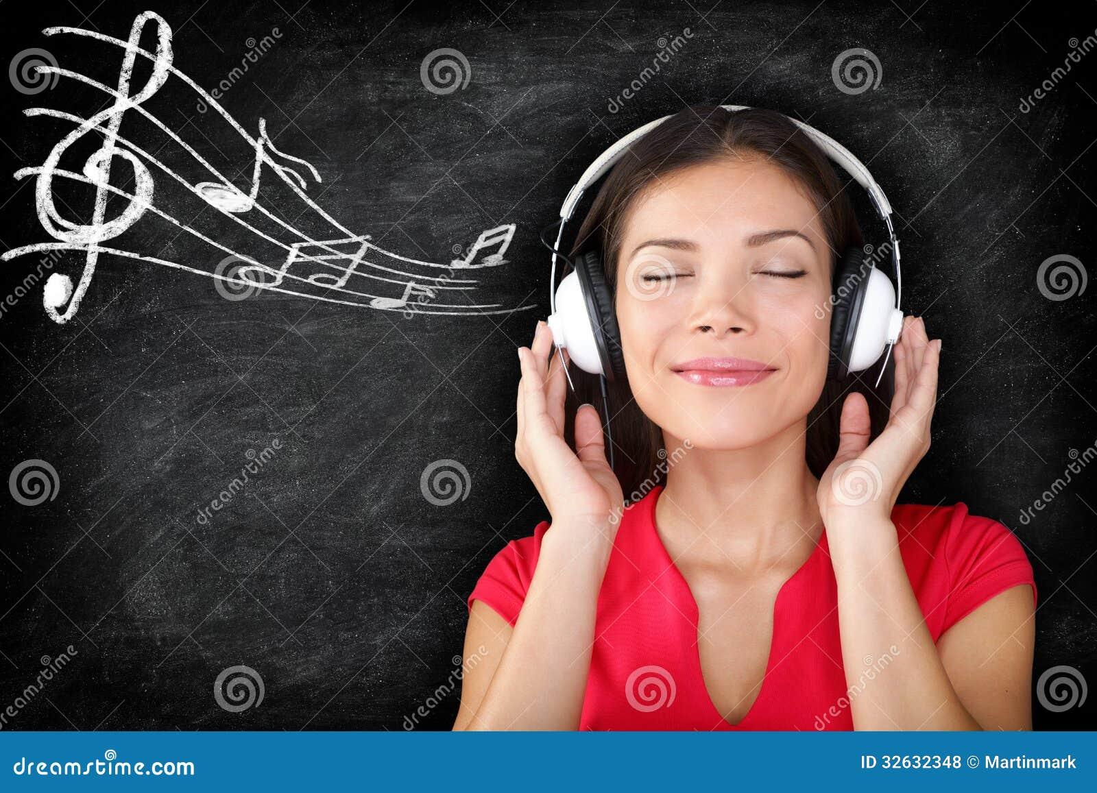 Music - woman wearing headphones listening to music