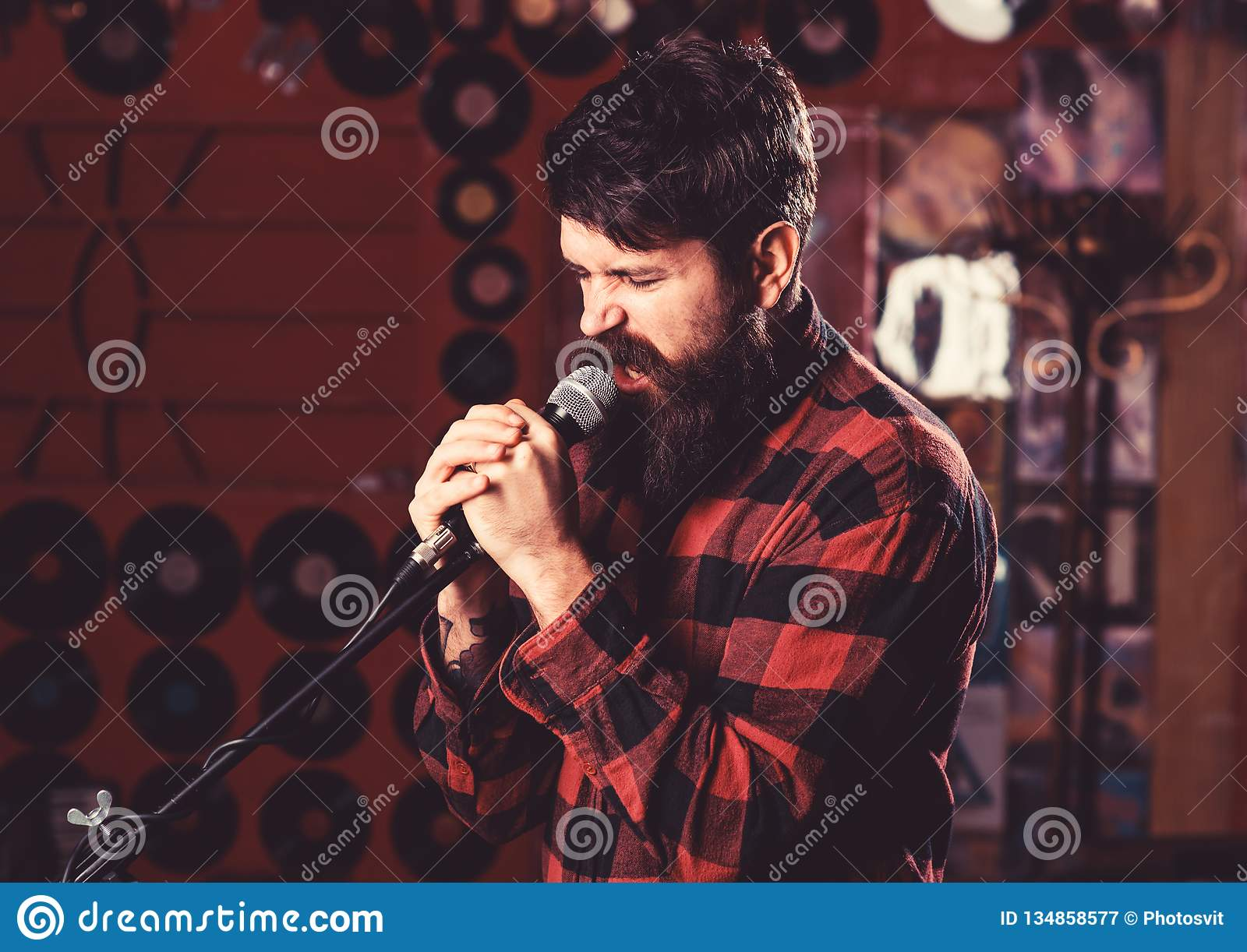 Musician With Beard And Mustache Singing Song In Karaoke  Stock