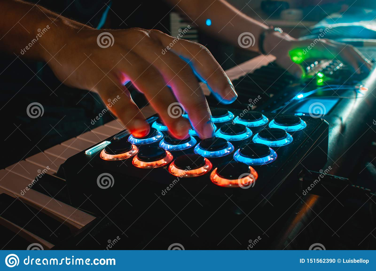 Musician hands playing a midi pad controller
