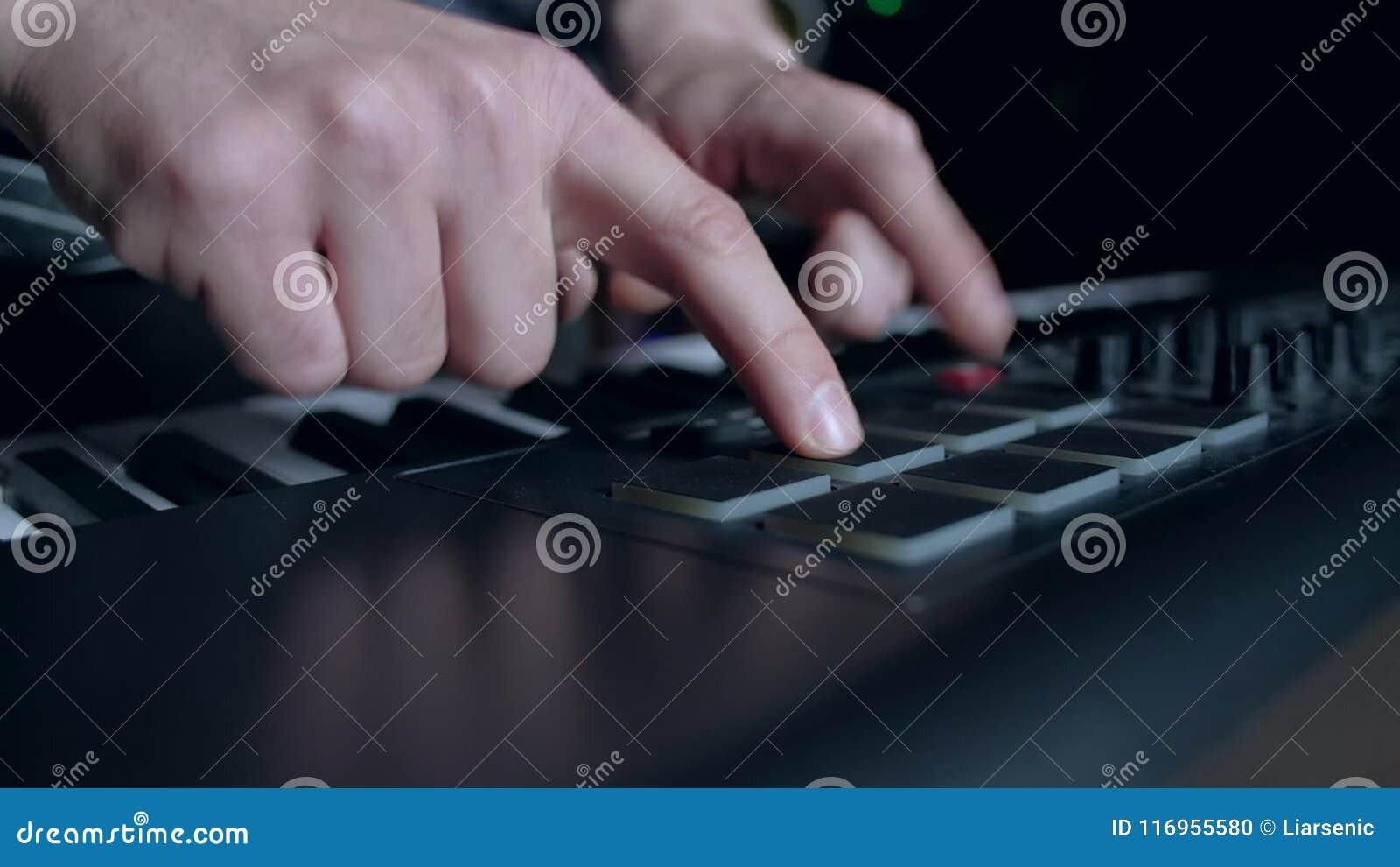 Musician plays a MIDI keyboard  Bokeh, classical