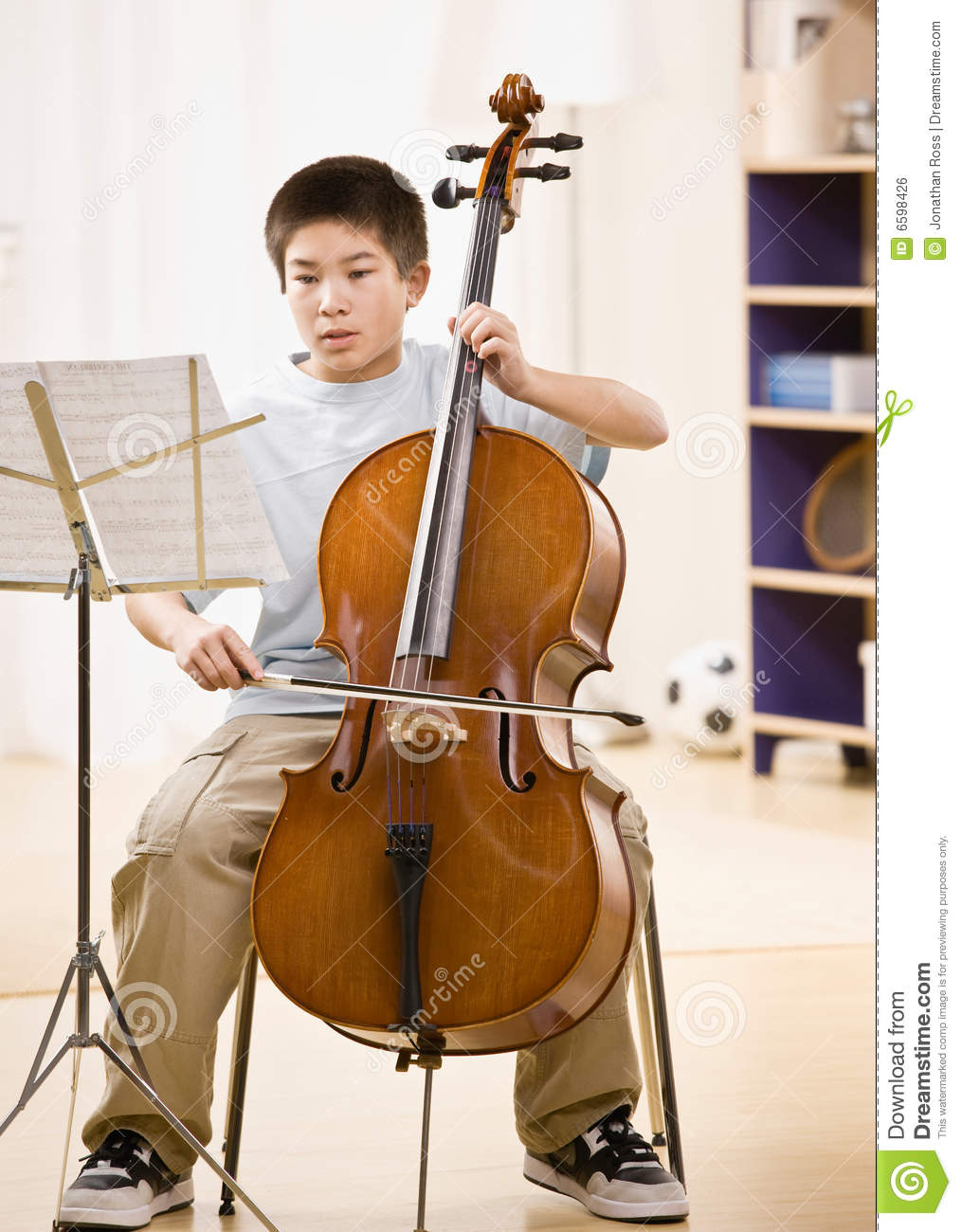 Musician practices performing on cello