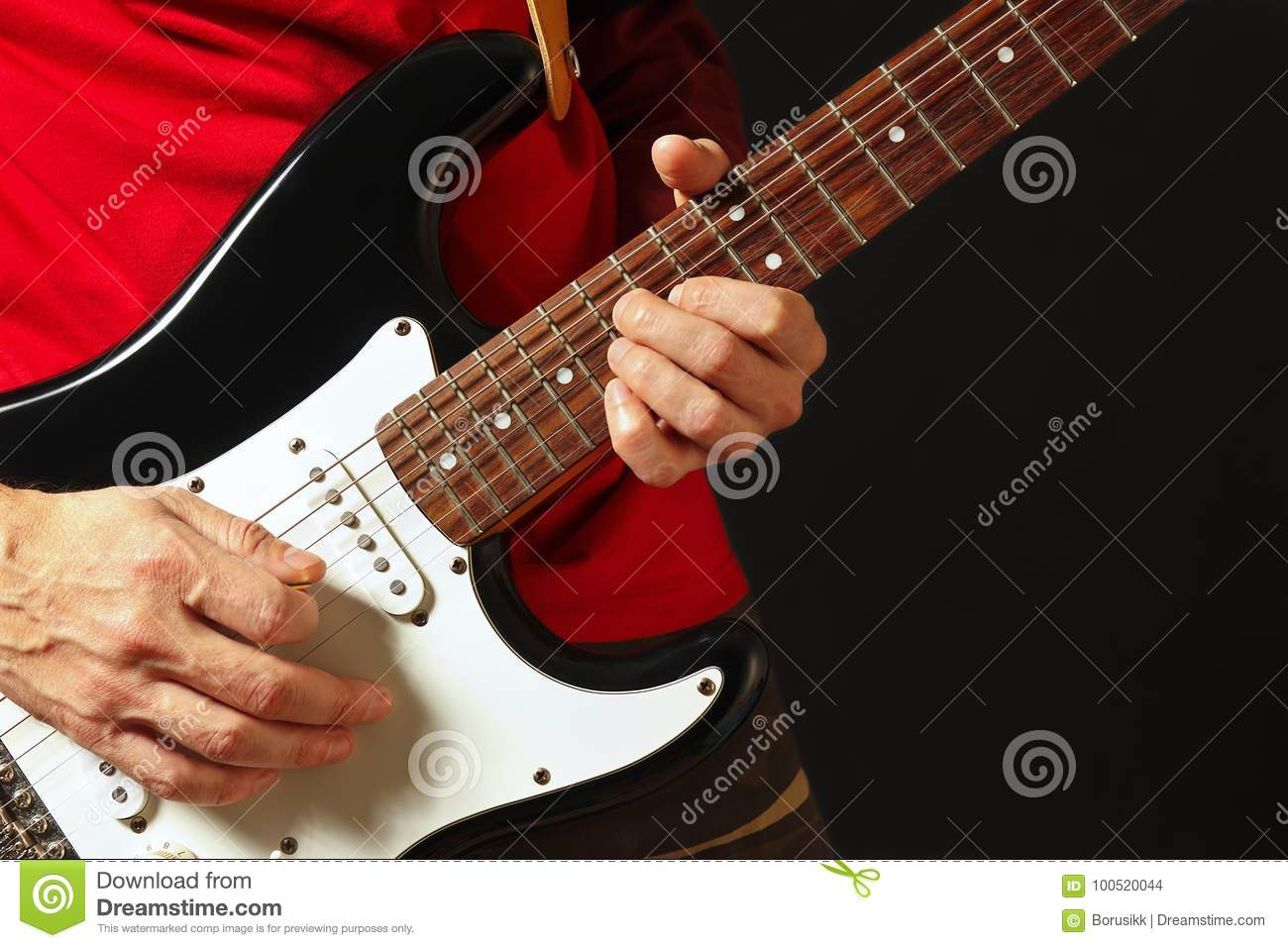 Musician Put Fingers For Chords On Electric Guitar On Black