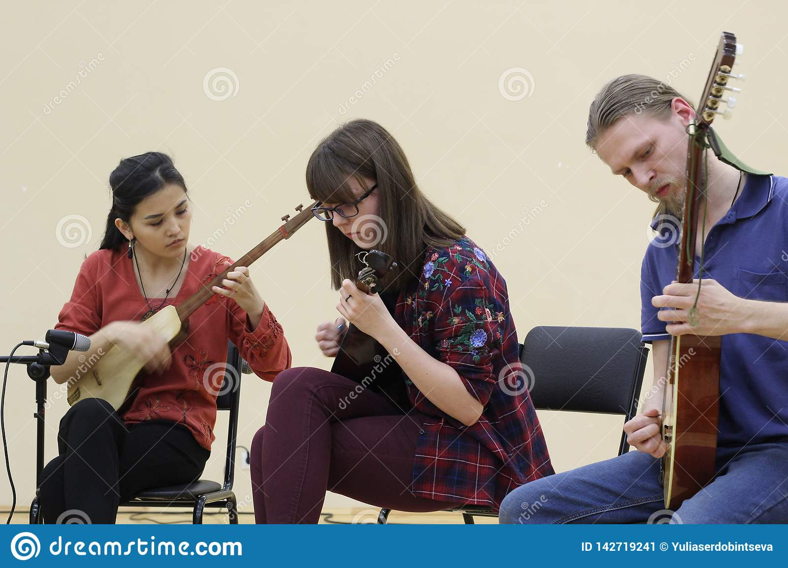 Musicians of different ethnicities play together on different musical instruments. Russia, Saratov-March 21, 2018