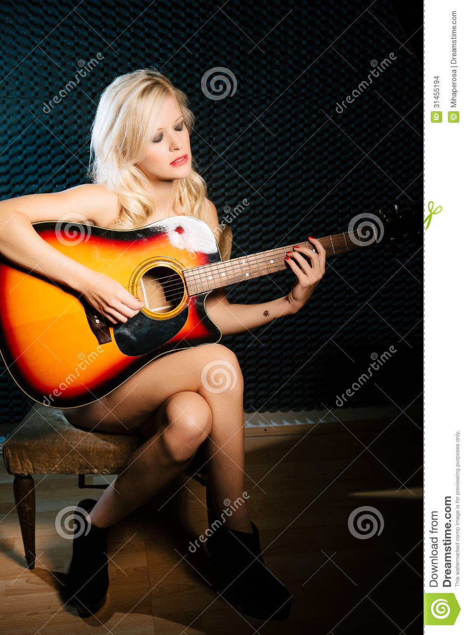 naked blonde woman playing guitar