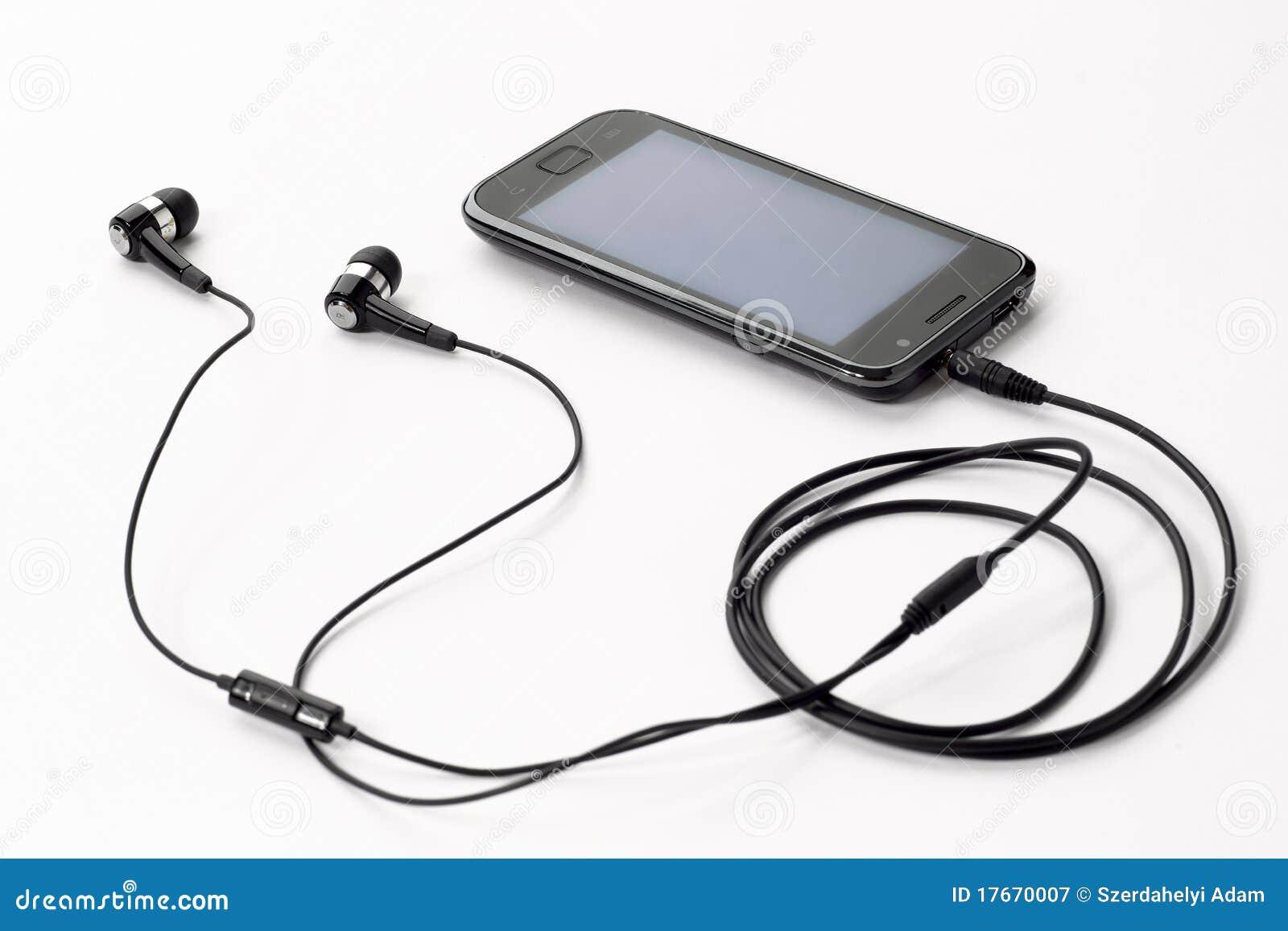 musique de coute avec le t l phone portable image stock image du libre aide 17670007. Black Bedroom Furniture Sets. Home Design Ideas