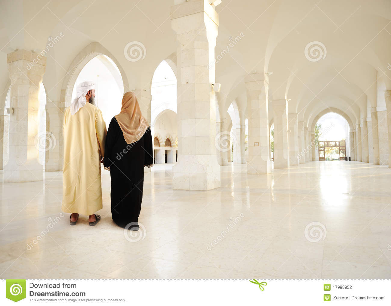 Muslim arabic couple inside modern building muslim arabic couple inside big oriental empty modern building