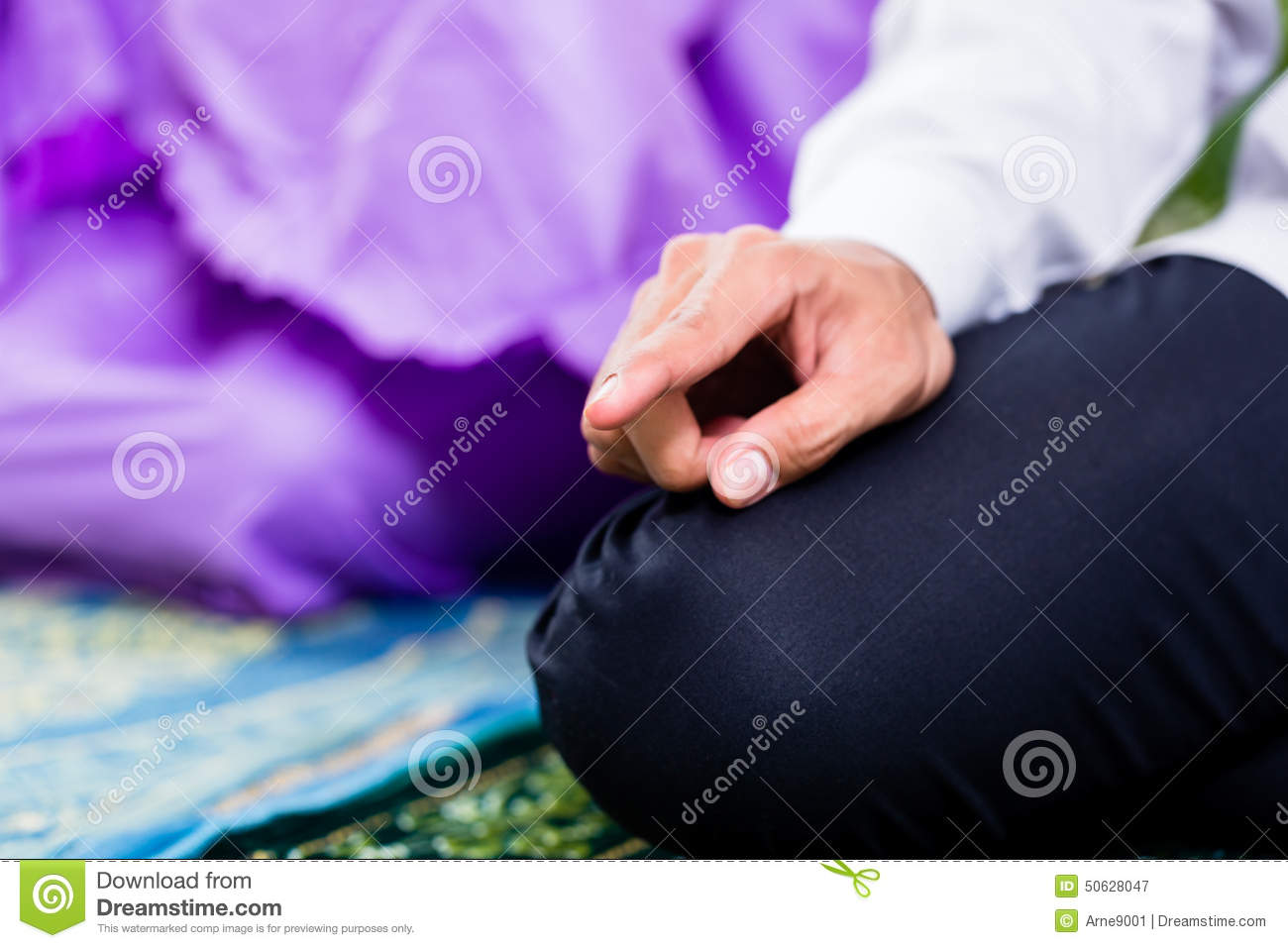 Muslim couple man and woman praying at home muslim couple men and