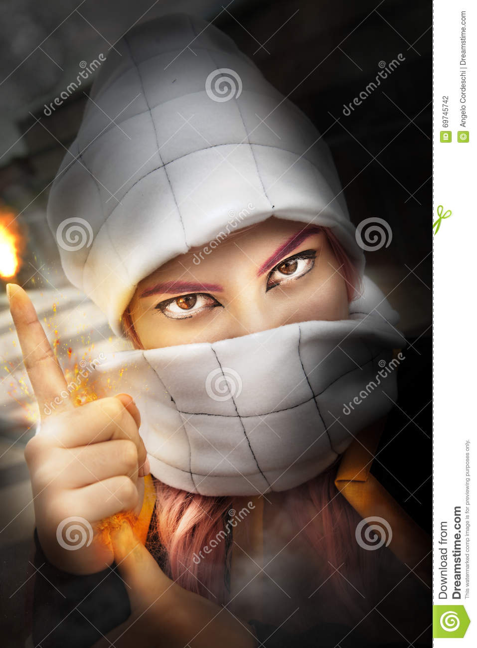 Muslim fire in hand. Cosplayer. Woman with her face covered