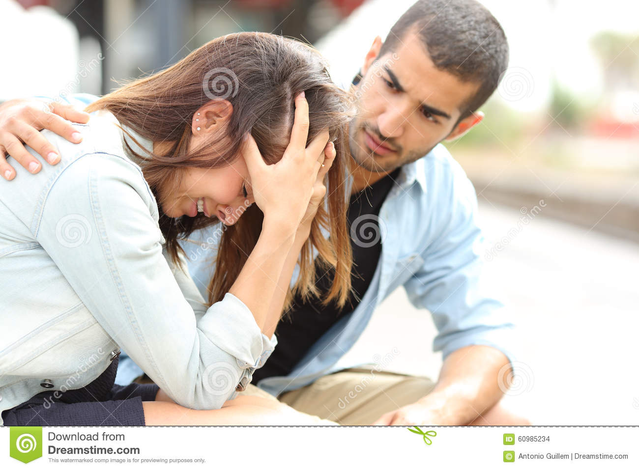 Muslim man comforting a sad girl mourning