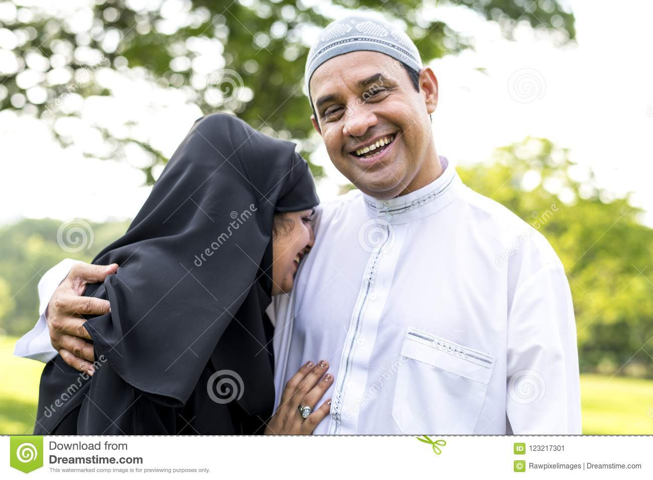 Muslim Married Couple In The Park Stock Image - Image of