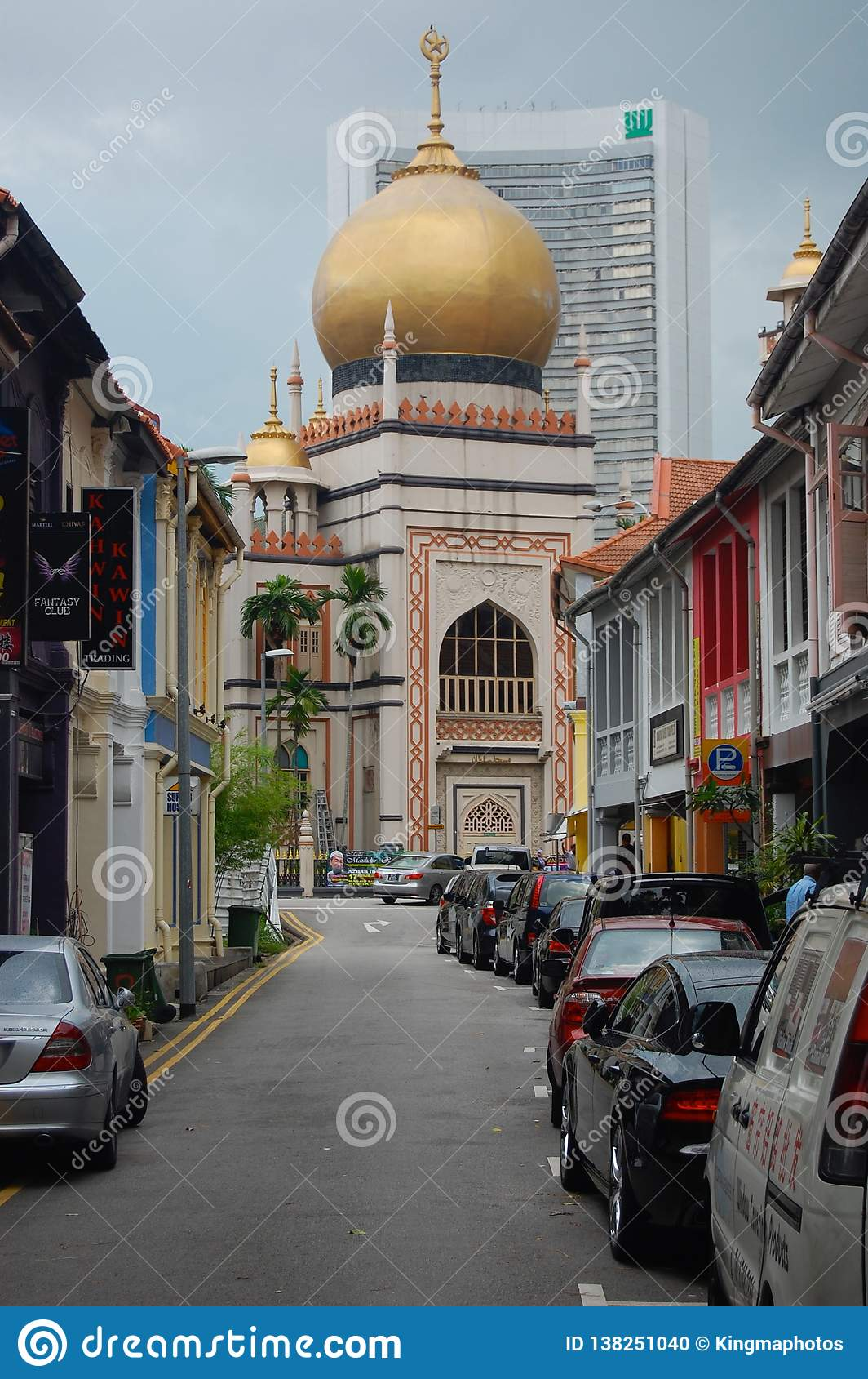 Muslim Quarter in Singapore on a partly cloudy day showing off the streets and mosque attraction for the Muslim population an