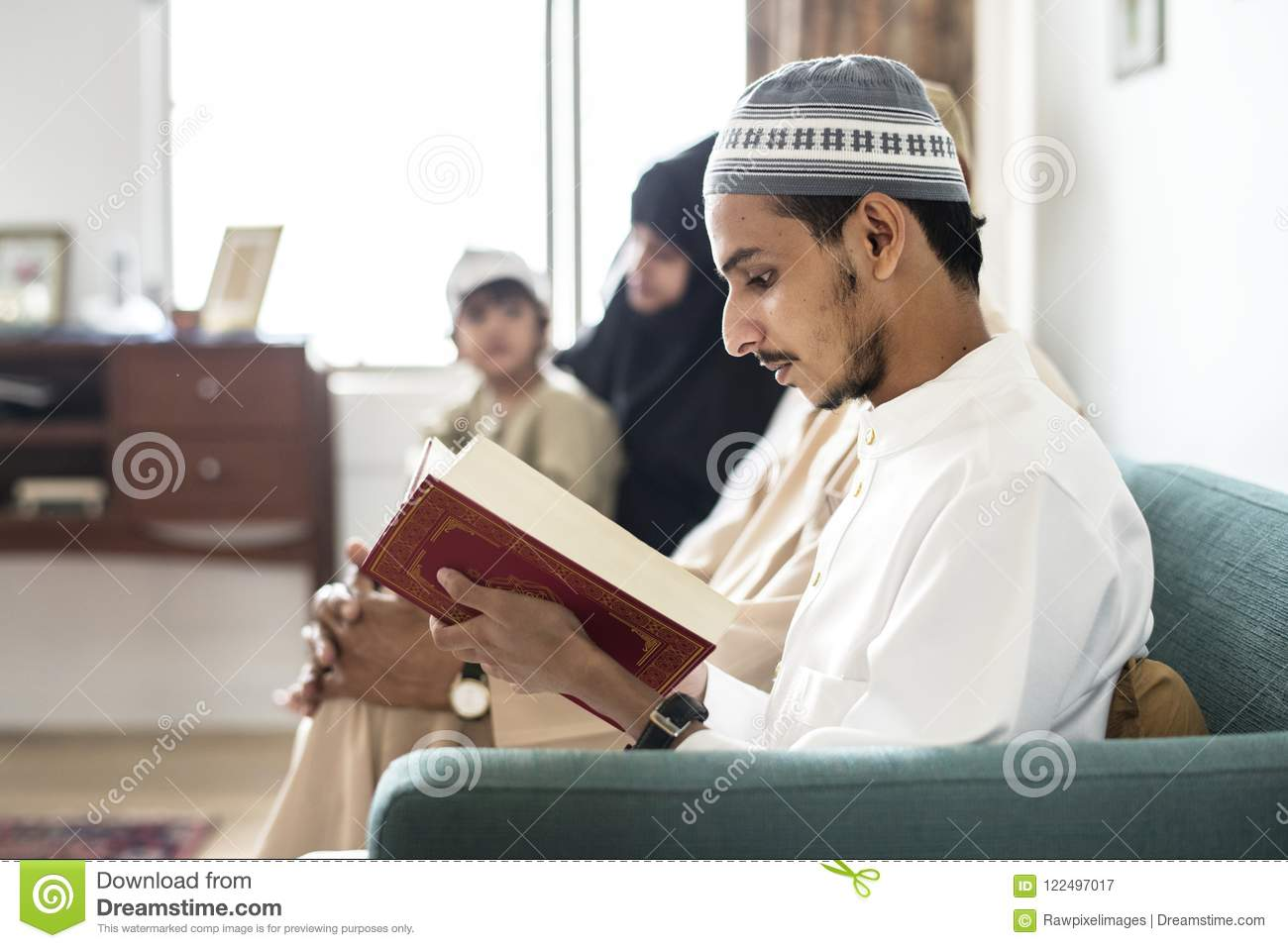 Muslims Reading From The Quran At Home Stock Image - Image of mosque