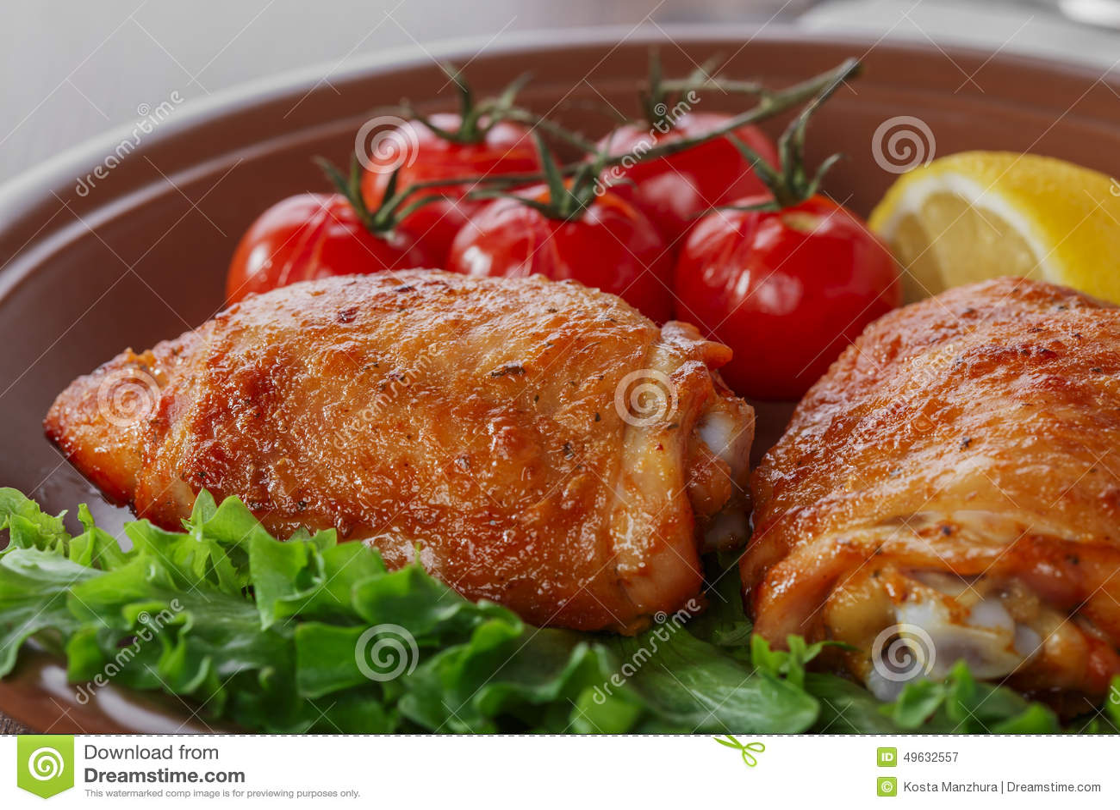 Muslo cocido del pollo