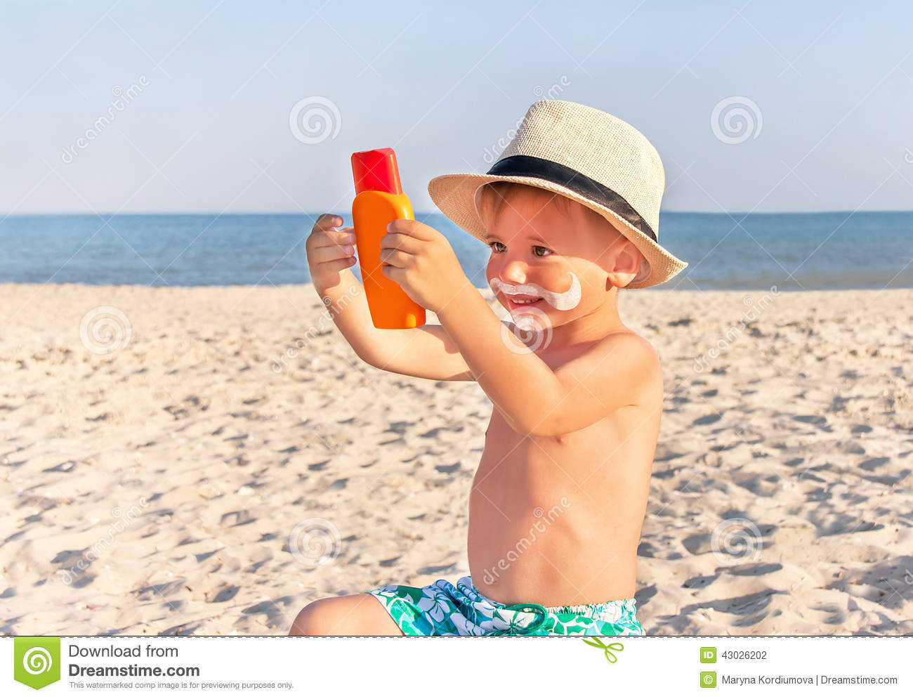 The Mustache Drawing Sunscreen On Baby boy Face Stock