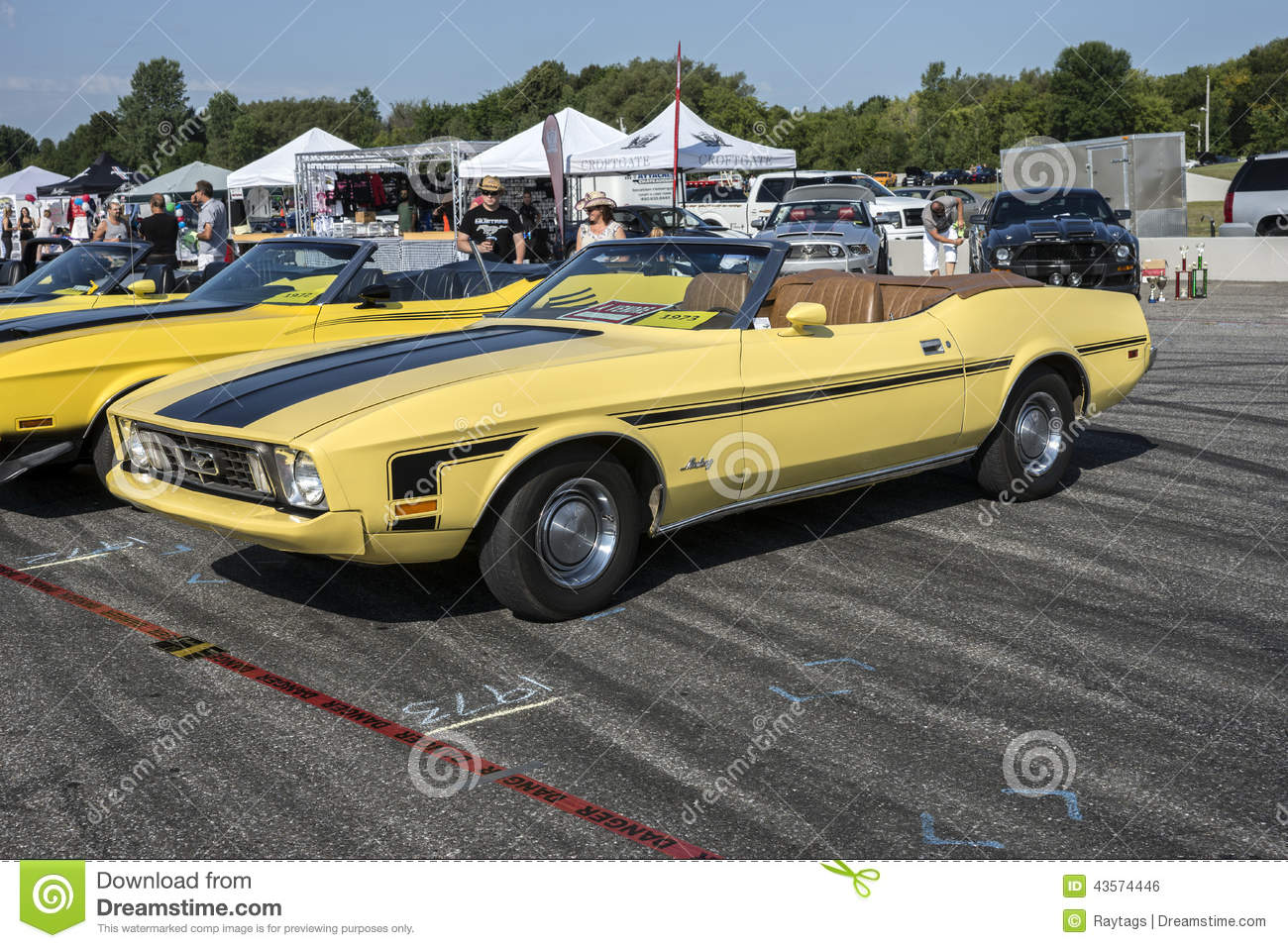 Sanair august 9 2014 front side view of yellow mustang convertible with top down and ginger interior color at 19e super ford show