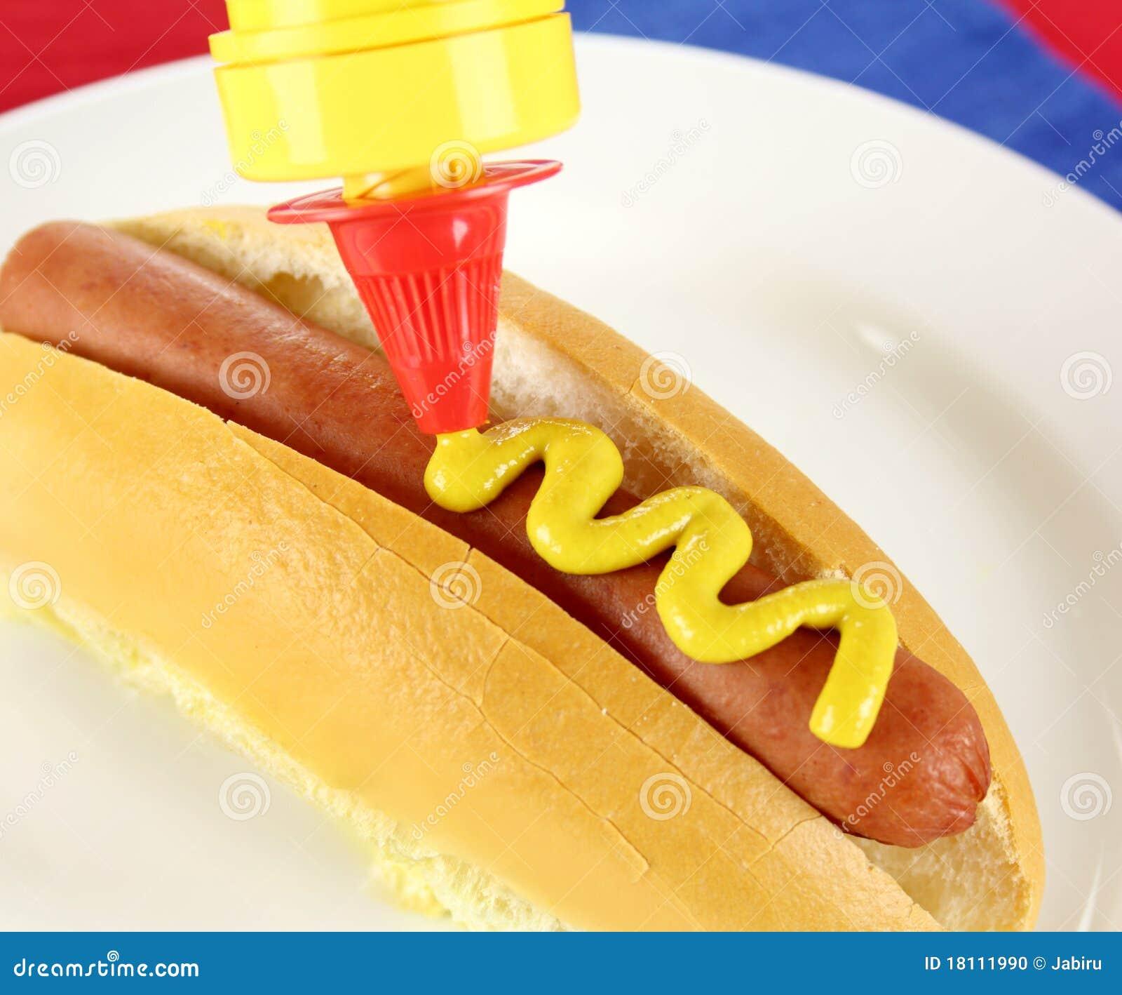 mustard on hot dog stock photo image 18111990. Black Bedroom Furniture Sets. Home Design Ideas
