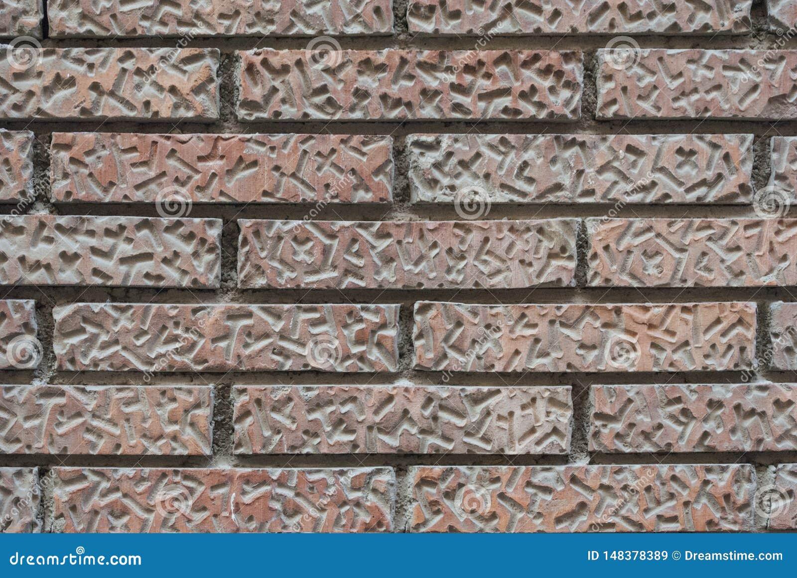 Muur van oude rode bakstenen met een patroon
