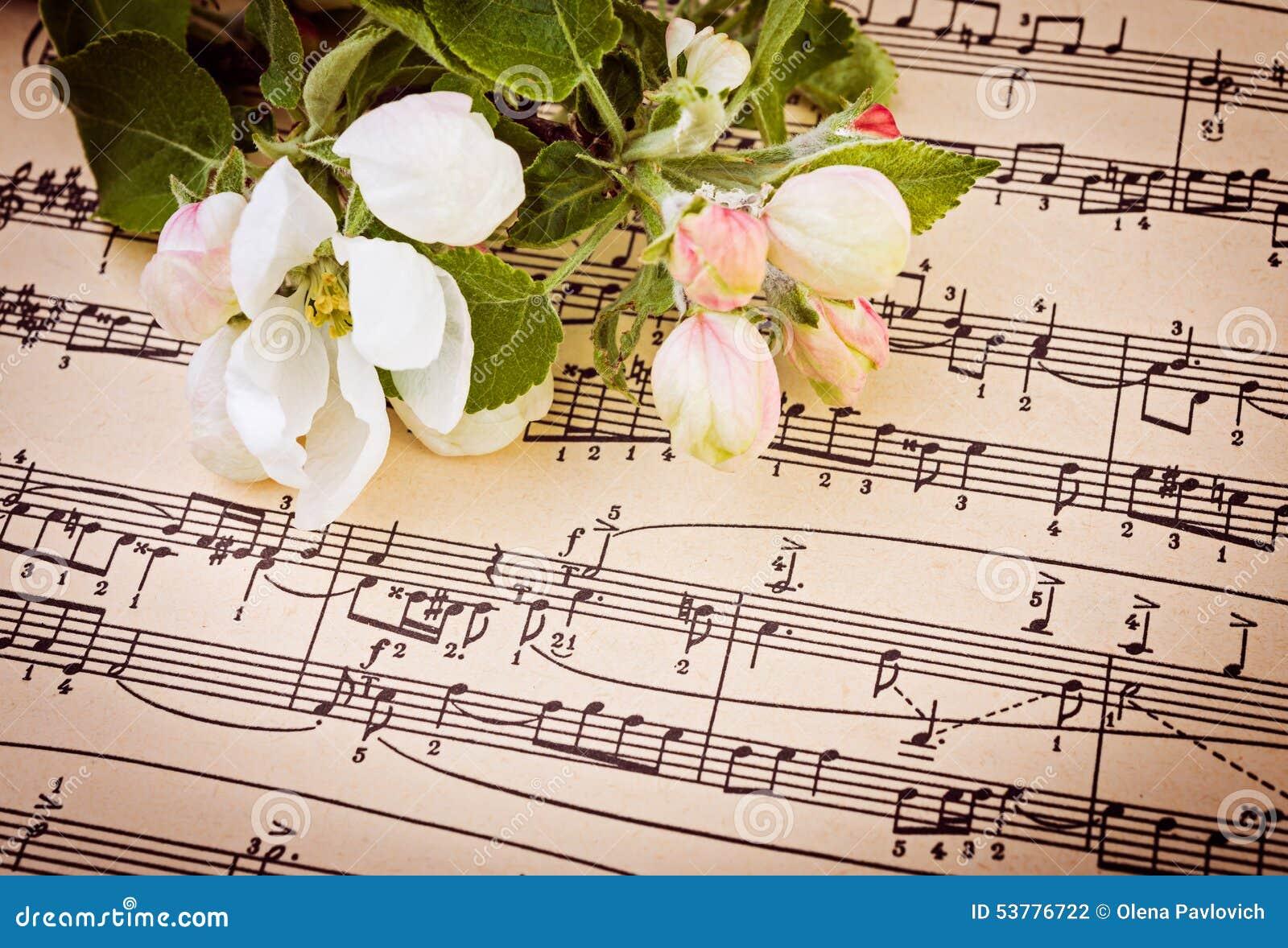 Muzykalny tło z jabłczanymi kwiatami