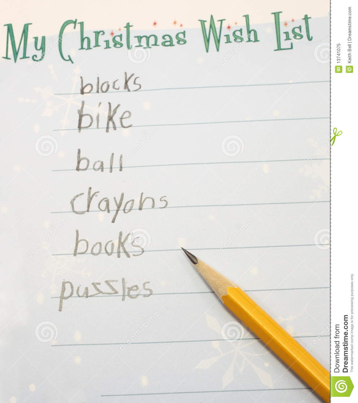 child's Christmas Wish list with a pencil showing the toys desired.