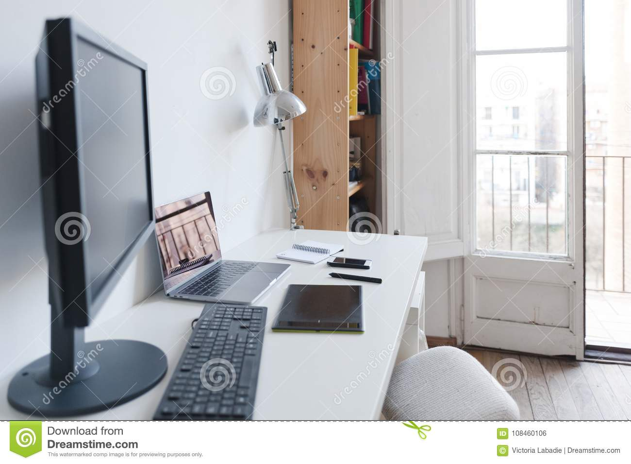 Home Office White Table, Big Windows And Computers Stock Photo ...