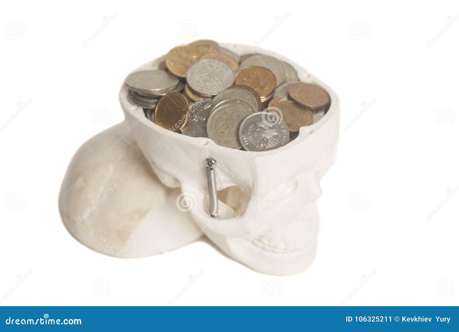 Mynt i skallehuvud