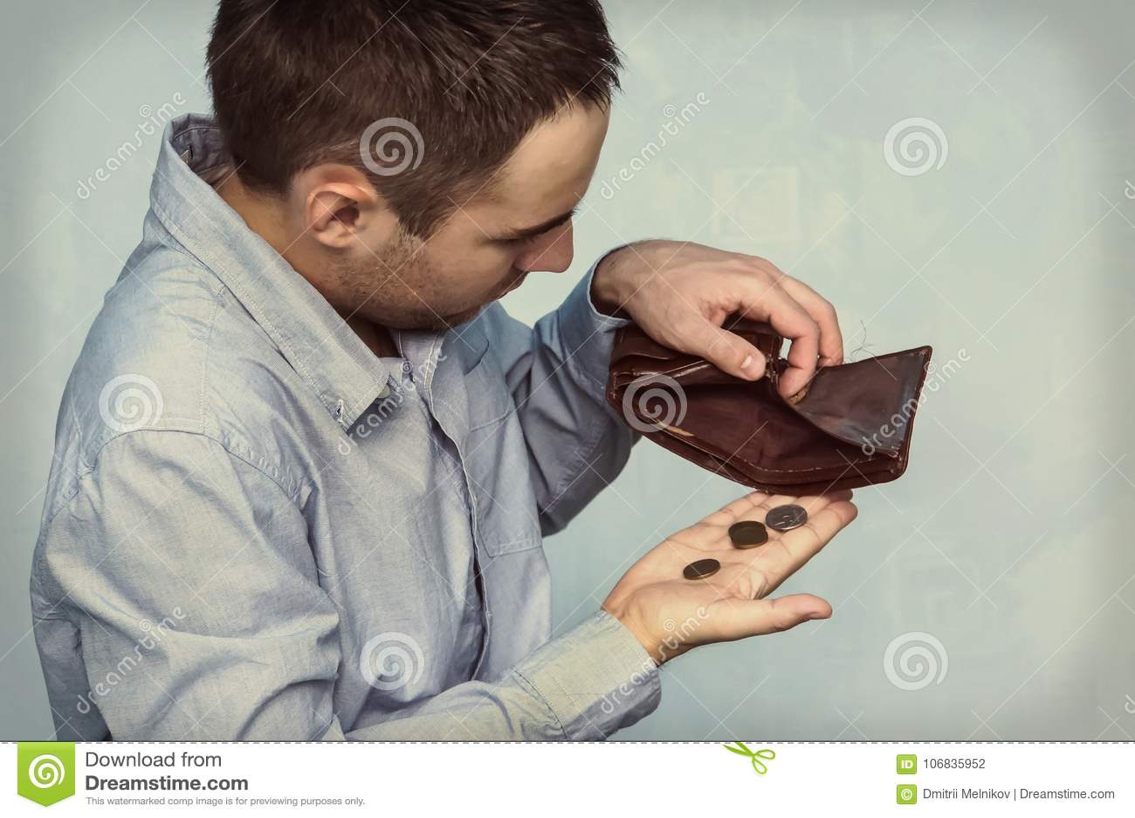 Mynt och en tom plånbok