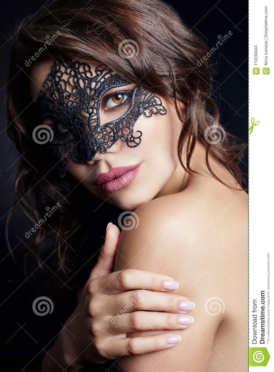 Mysterious girl in a black mask, masquerade. Nude brunette