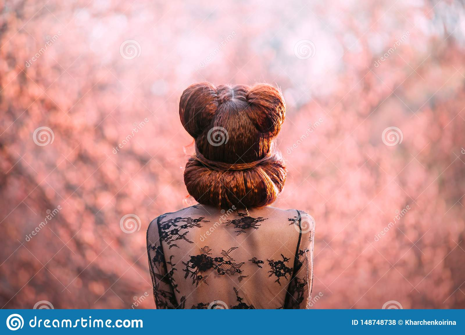Mysterious lady, with a creative hairstyle pin-up, shooting from the back without a face. Red hair creatively twisted in