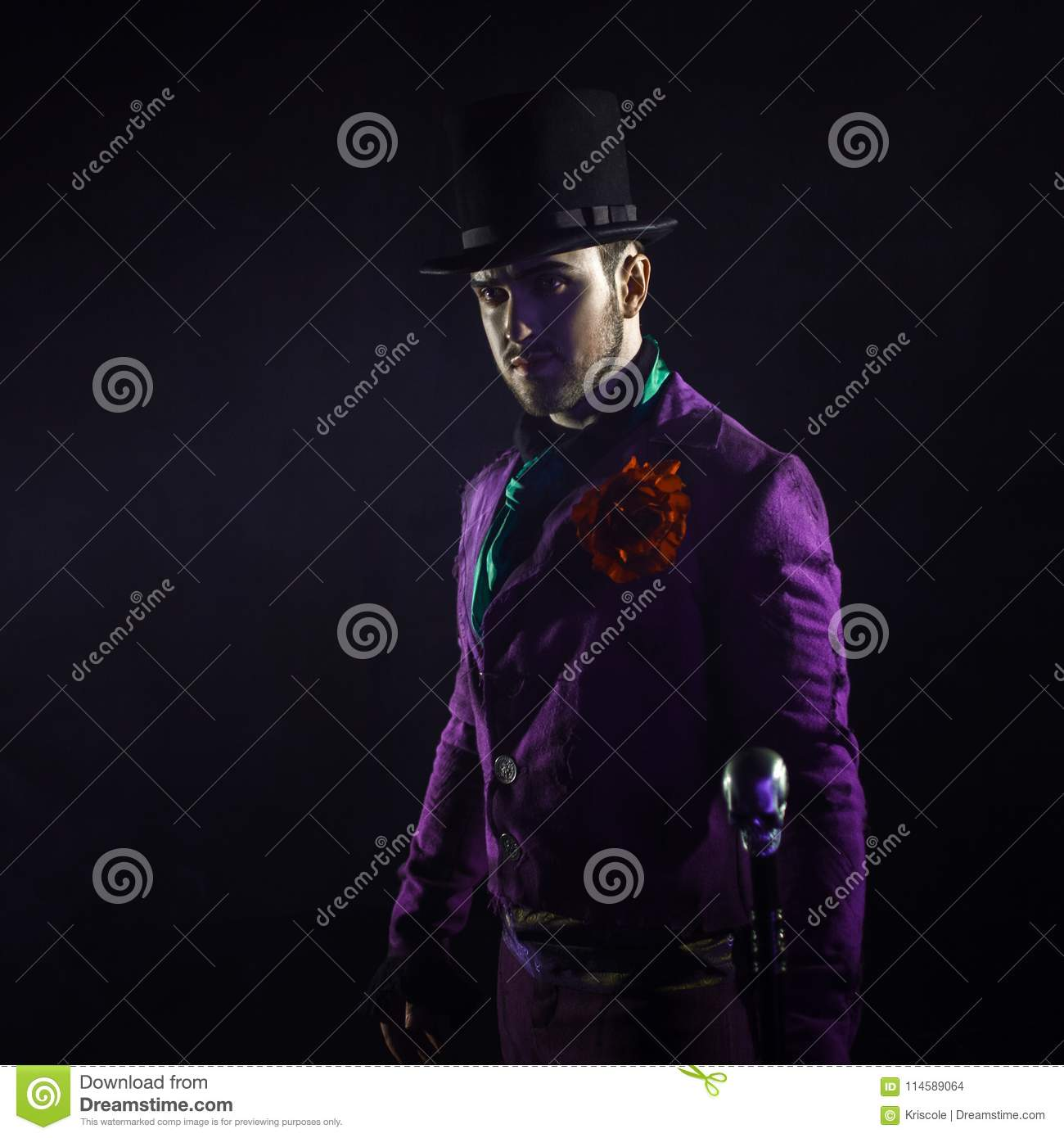 Joker Halloween costume. Royalty-Free Stock Photo. Download Mysterious Man In A Suit With A Cane In A Cylinder. Dark & Mysterious Man In A Suit With A Cane In A Cylinder. Dark ...