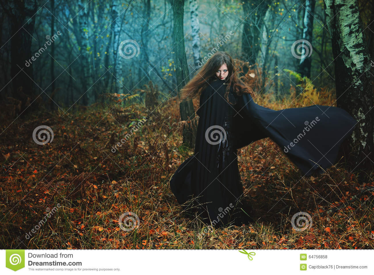 Mysterious woman walking in magical forest