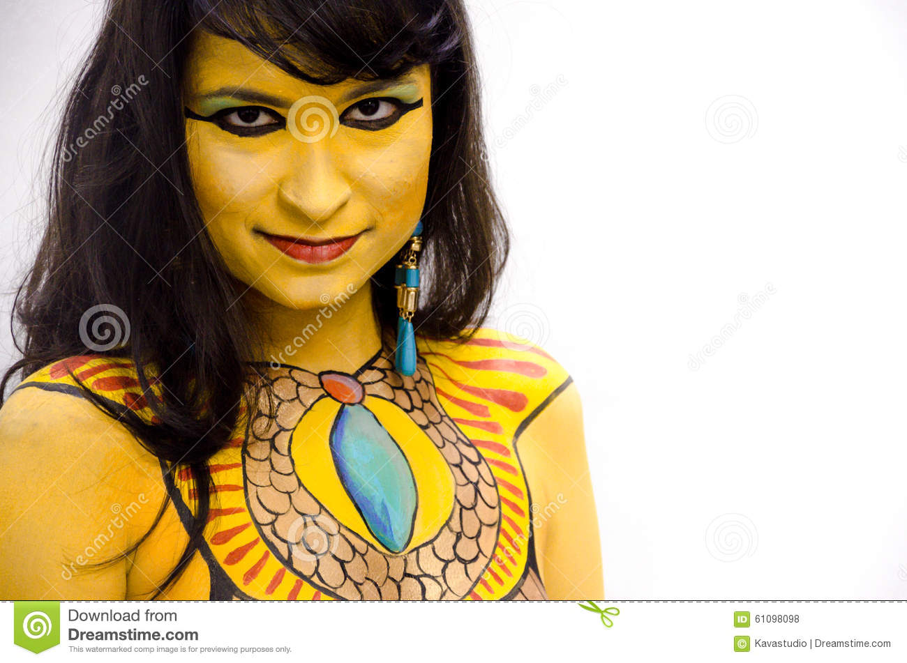 Mysterious yellow bodypainted tribal face of a girl on a white background.