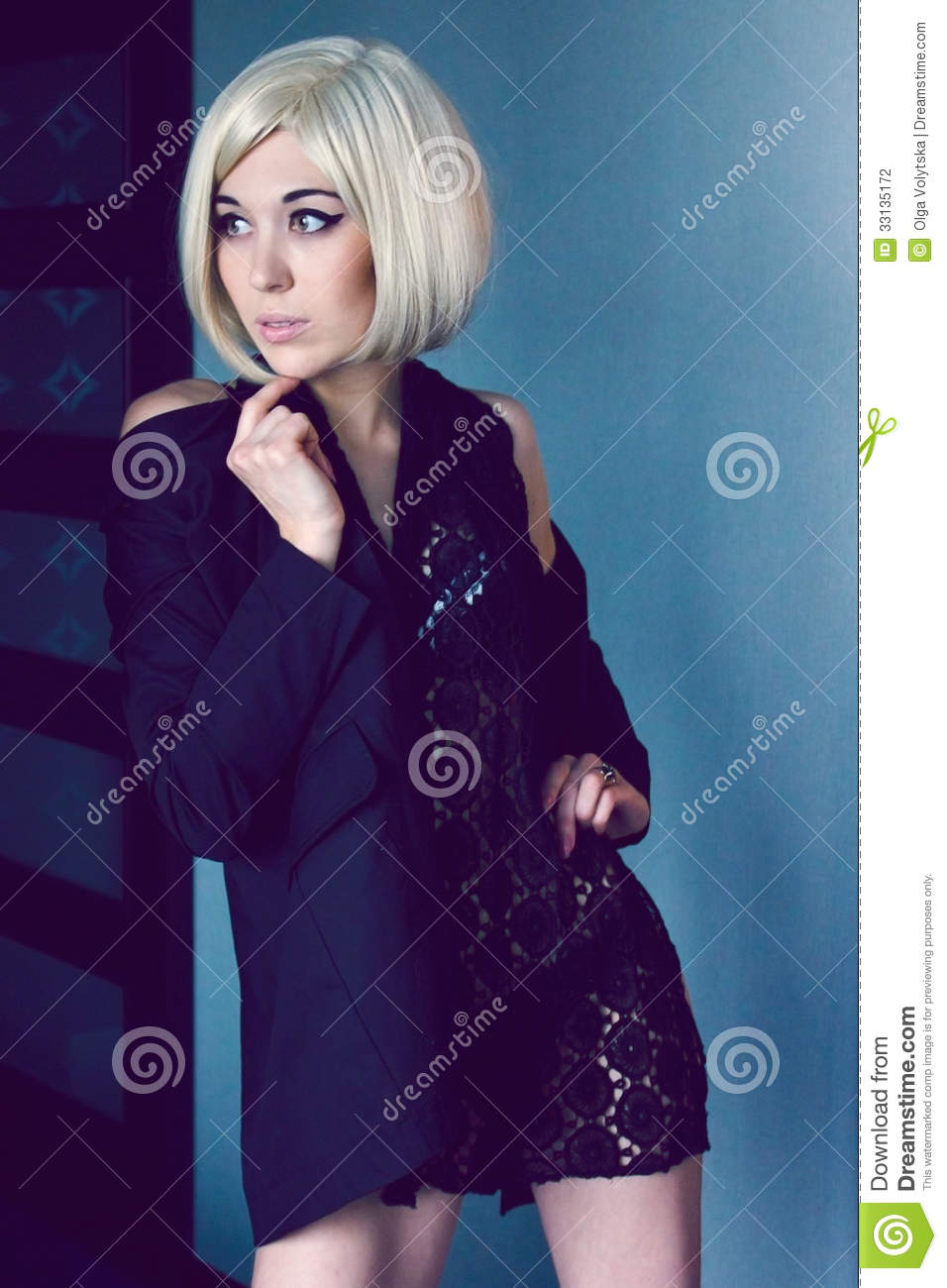 Mysterious young woman in jacket and lace scarf