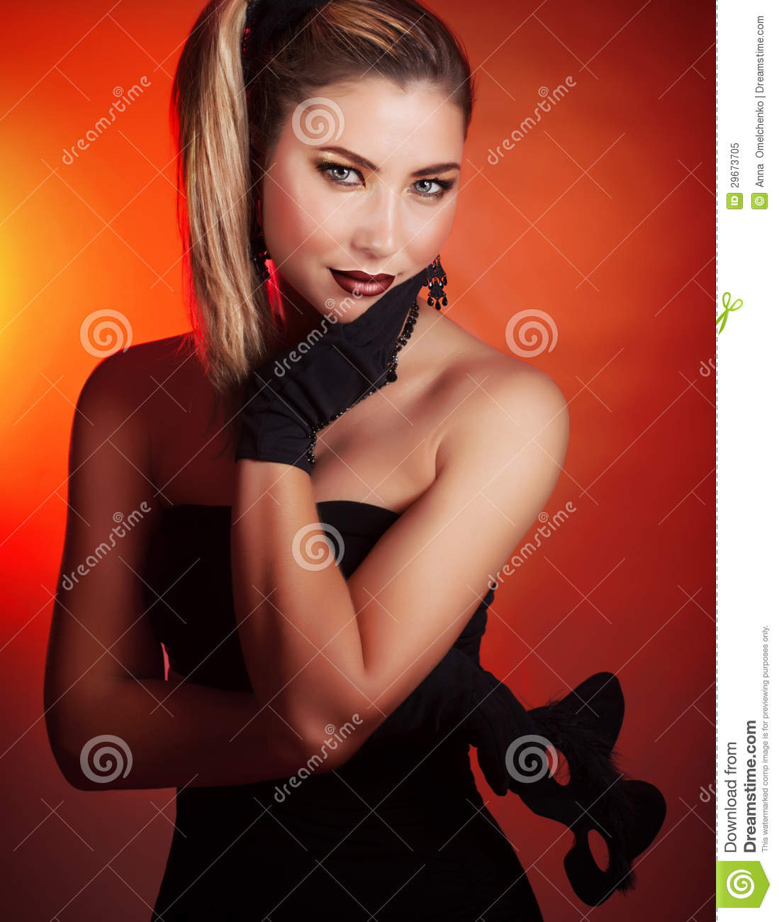 With stylish mask isolated on red background cute woman wearing