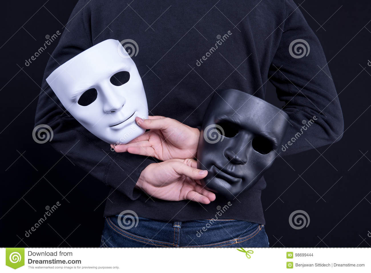 Mystery man holding black and white mask
