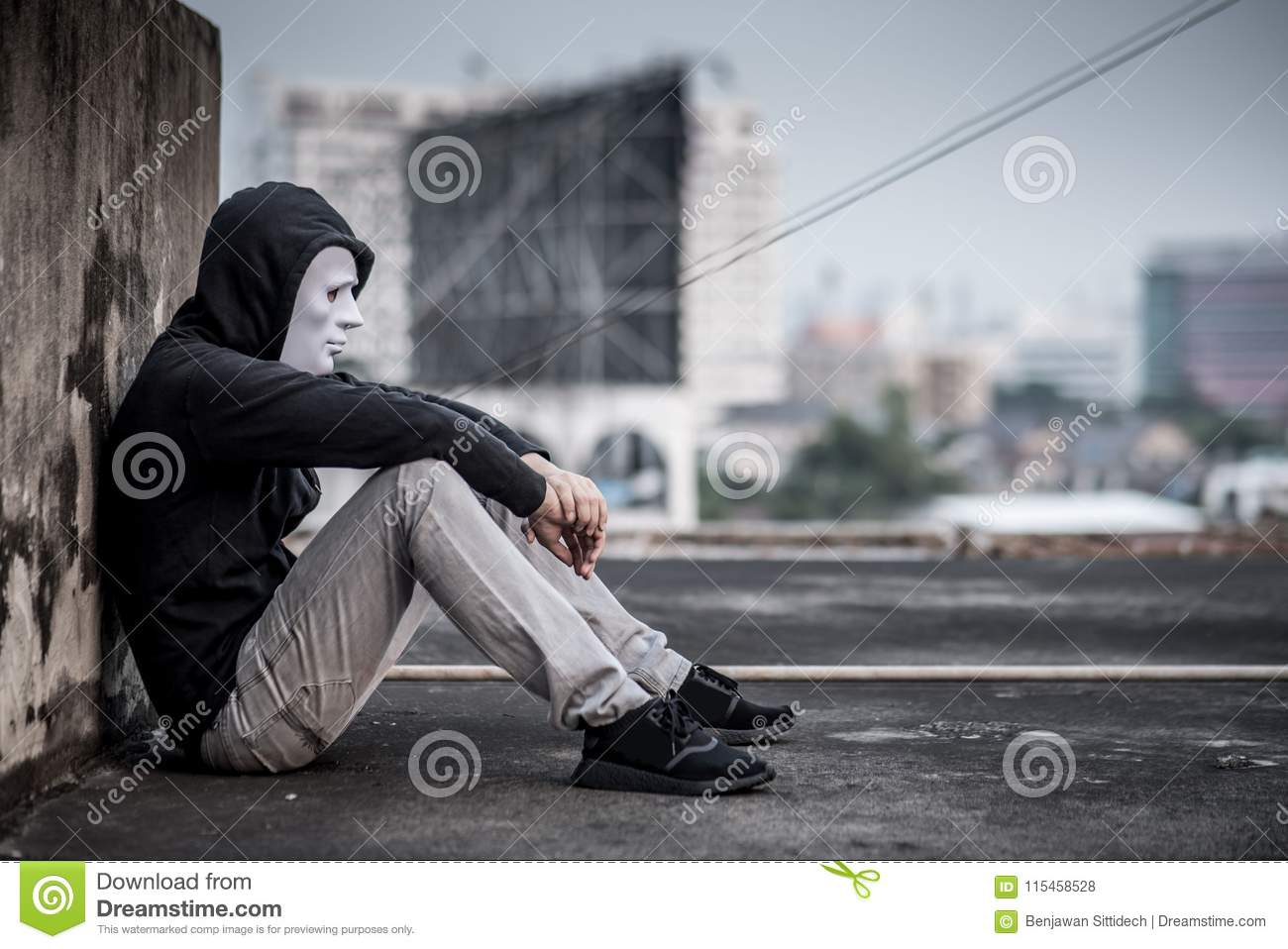 Mystery man in white mask feeling sad and depressed