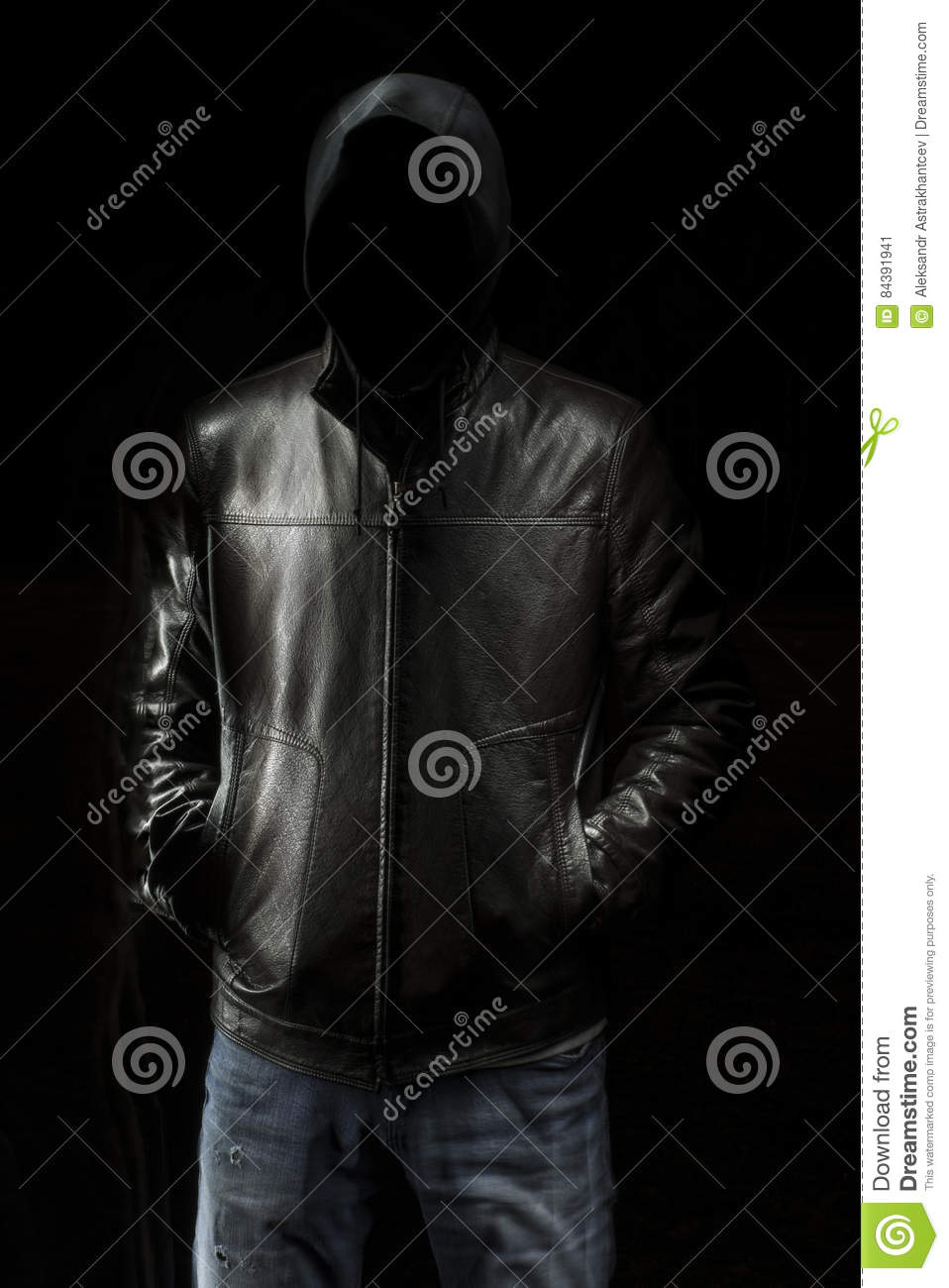 Mystic Black Hooded Man Standing In The Darkness. Stock ...