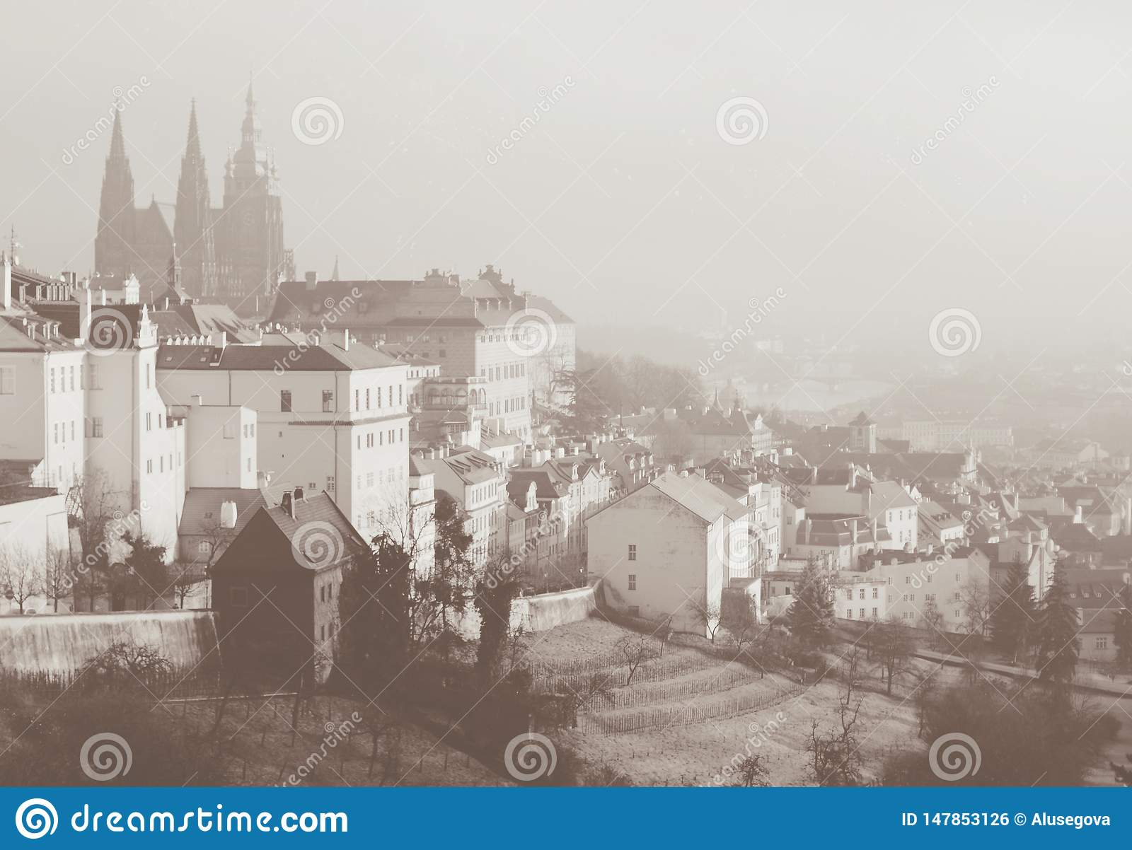 Romantic view on Praga from above. Sepia toned card in vintage retro style