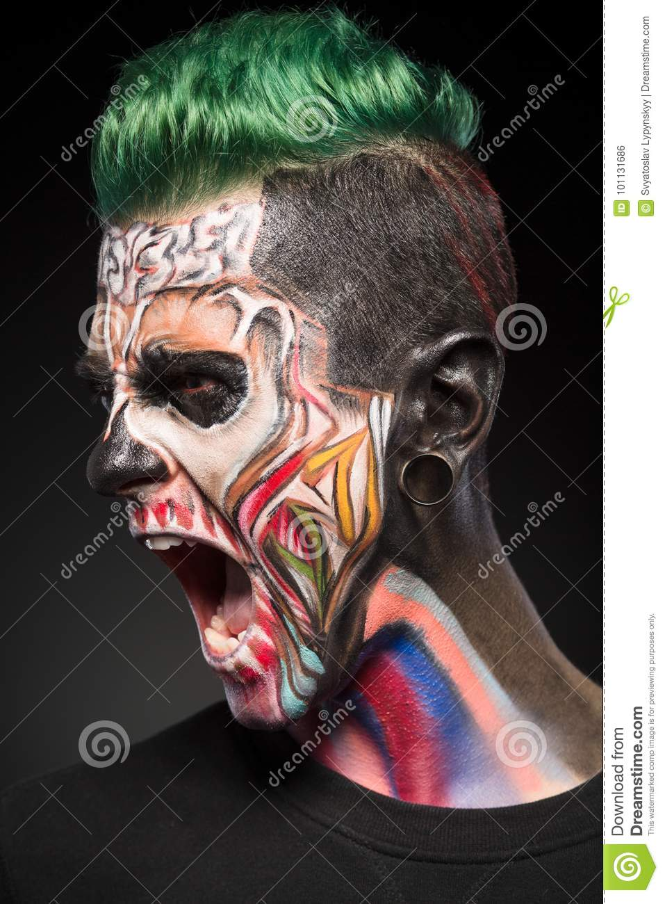 Mystical face art, scary skeleton man with open mouth showing teeth.