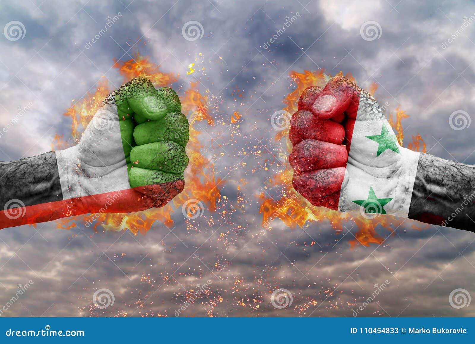Näve två med flaggan av Förenade Arabemiraten och Syrien vände mot på de
