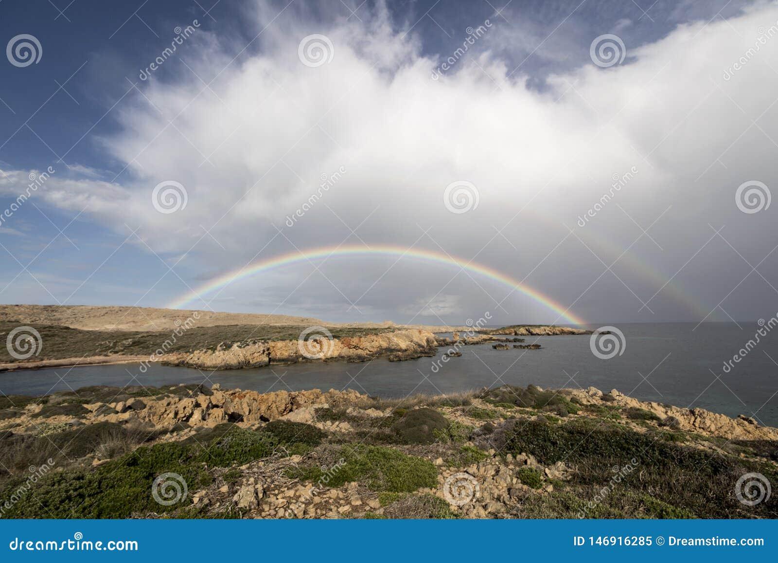Någonstans över den dubbla regnbågen